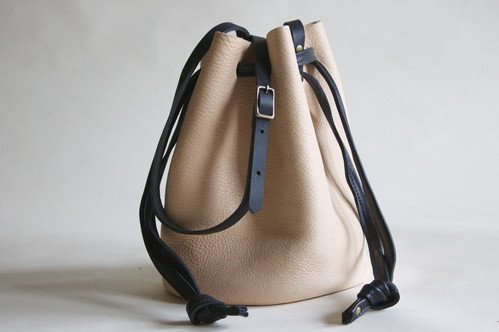 NEVA OPET BUCKET BAG (for sale at NOOWORKS.com): $260; made ethically in the USA by one artisan from vegetable-tanned leather.