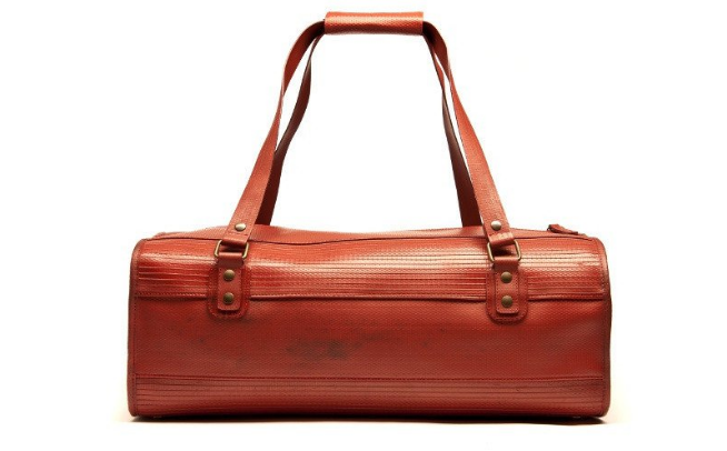 ELVIS & KRESSE OVERNIGHT BAG - about $283 (sold in UK pounds); B Corp Certified; made ethically from decommissioned fire houses and reclaimed military-grade parachute silk - comes with bonus reclaimed parachute silk dust bag.