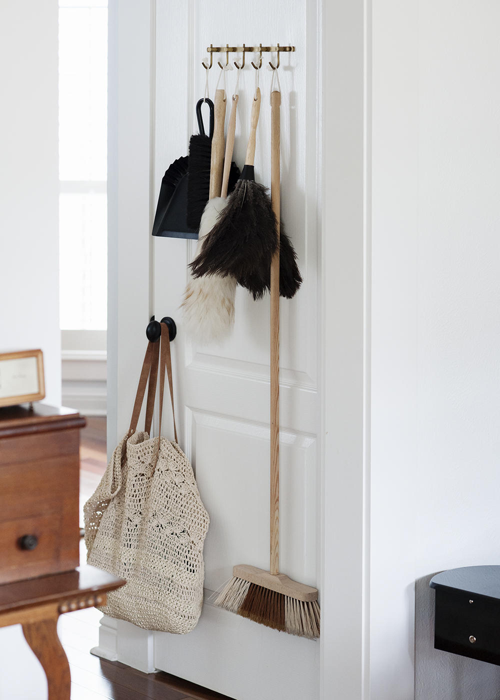 Cleaning doesn't seem as much of a chore when you display really pretty brooms and dusters.