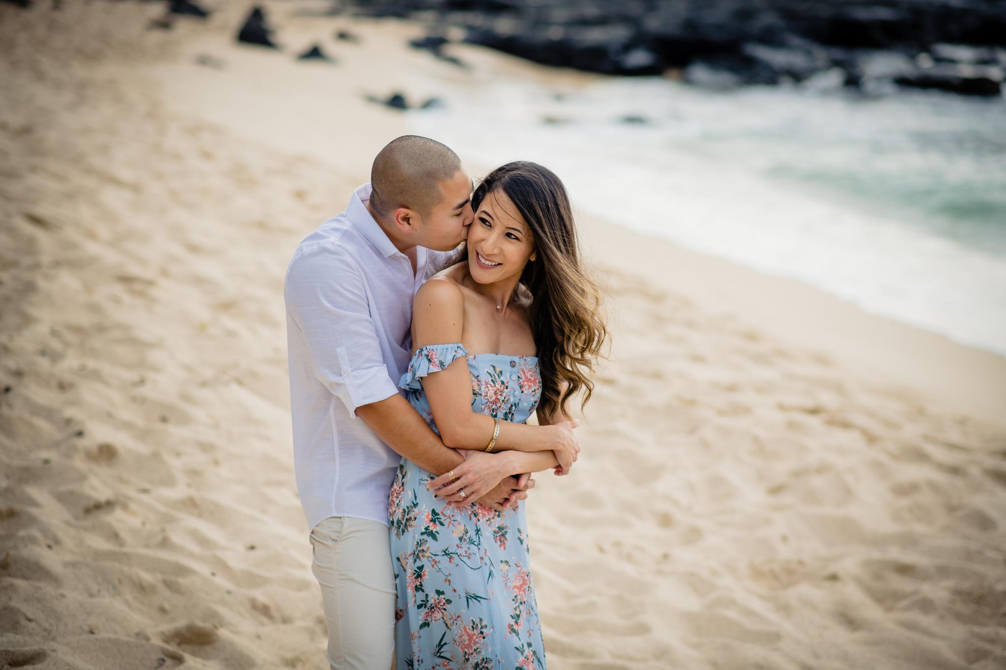guy kissing his fiancee