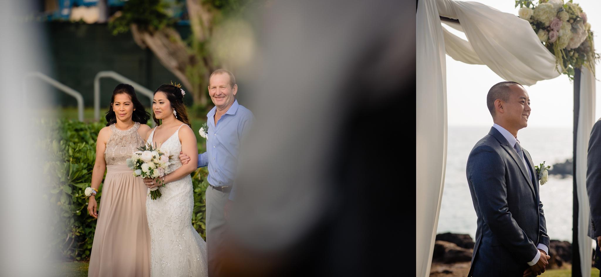 bride walking down and groom looking on