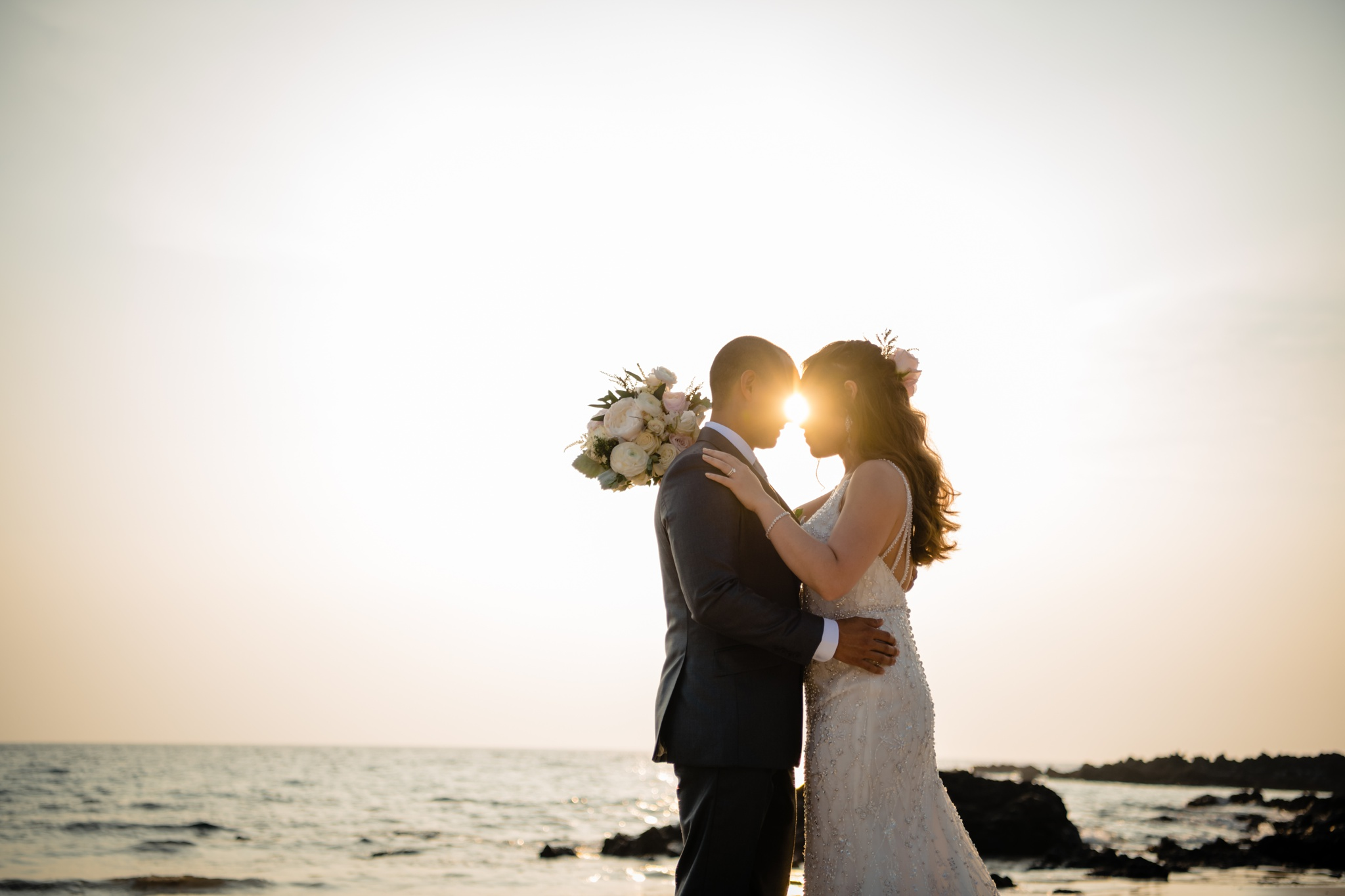 wedding couple at the beach with gorgeous sunset light