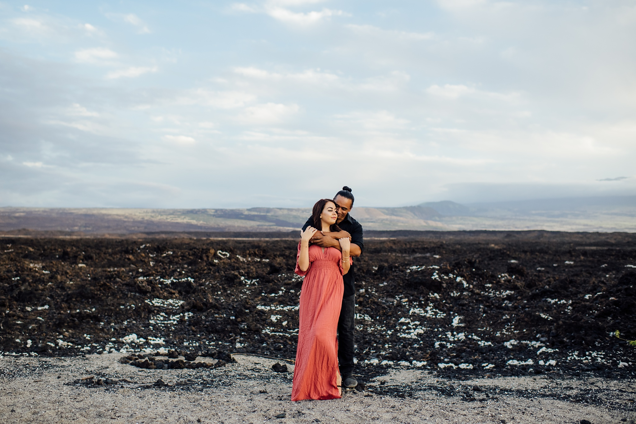 couple embracing on lava rock