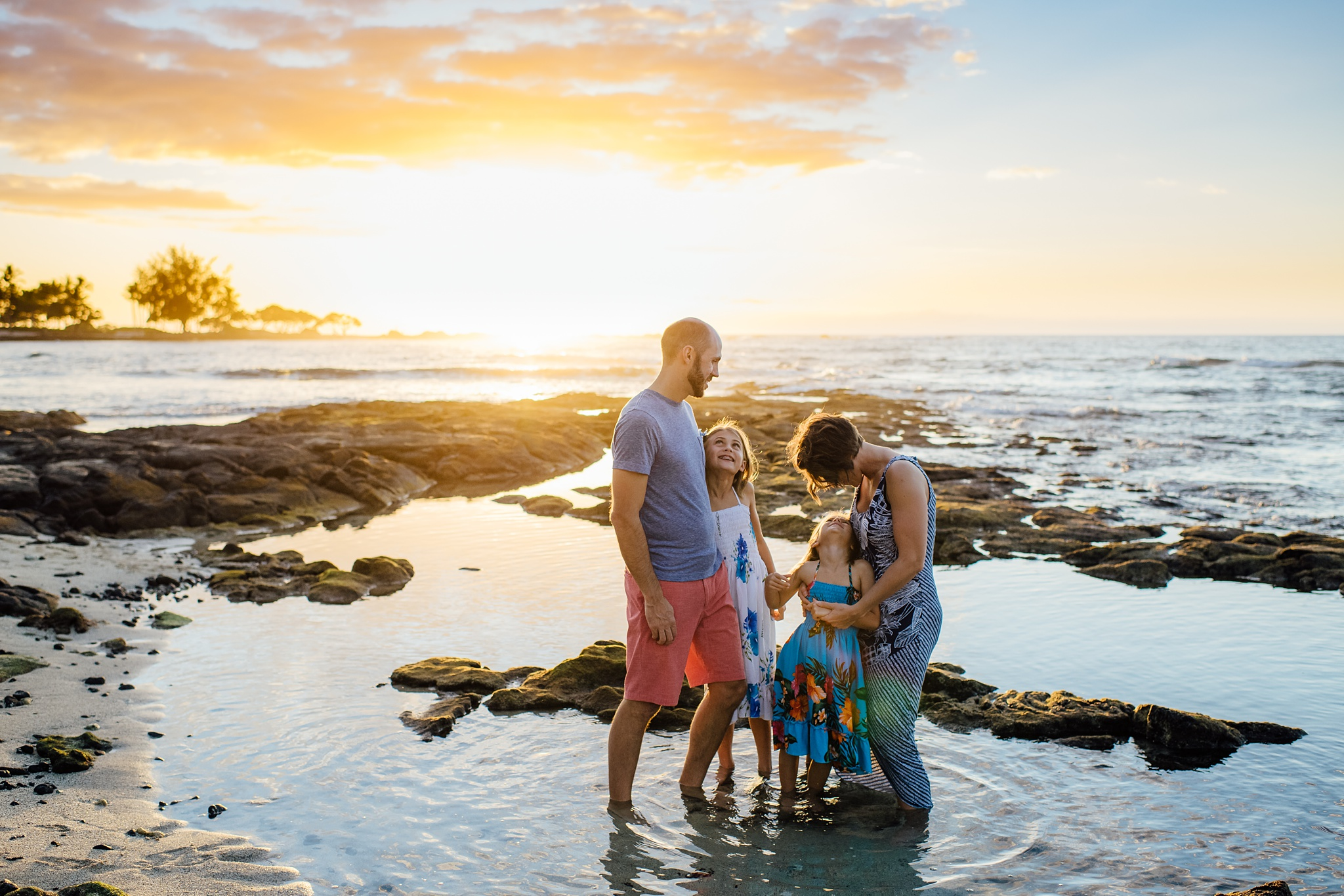 """- """"Ann is fantastic and her photos are even better!! We had so much fun and she really captured the feel of our family without us looking posed or stiff. The lighting and setting are also amazing. I would choose Ann again the next time we visit the Big Island!""""-April S."""