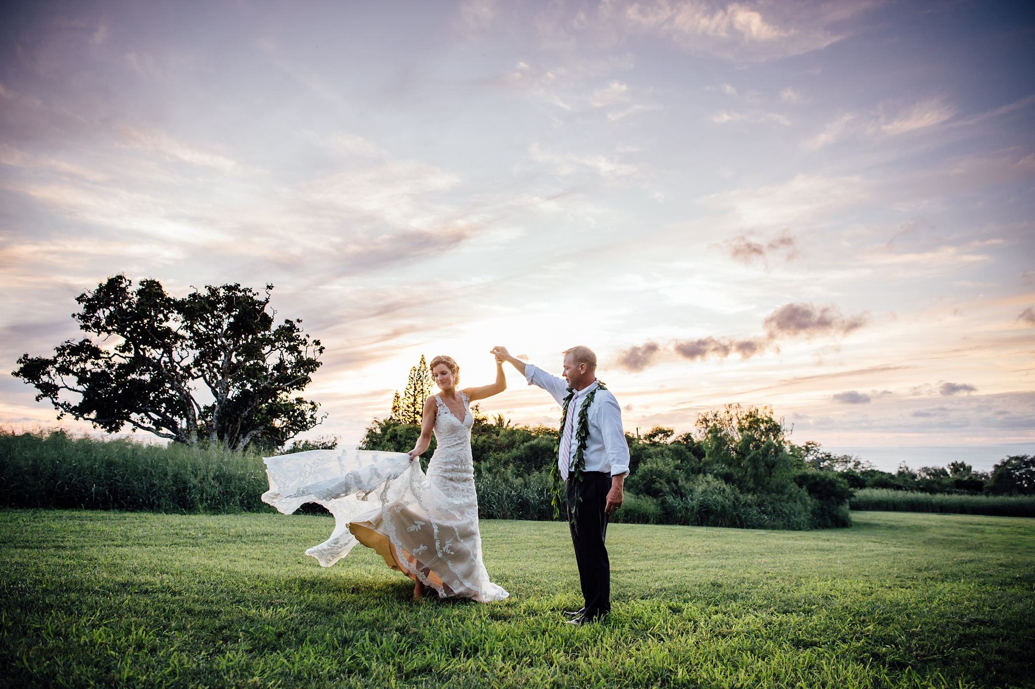 bride and groom dance at sunset, hawaii wedding photographer