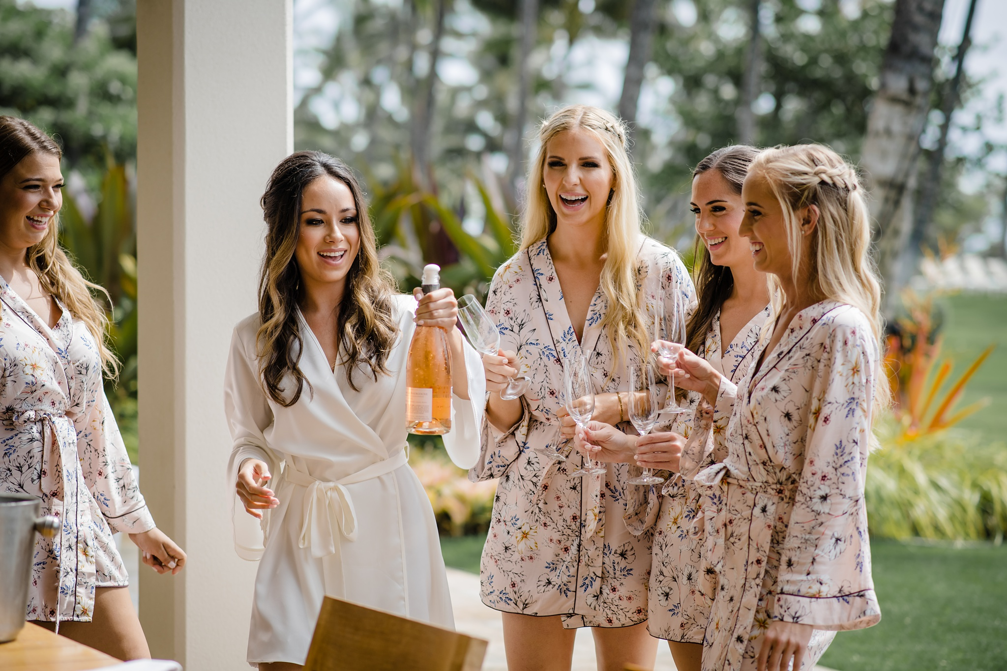Bride and bridesmaids toasting in celebration for her maui wedding