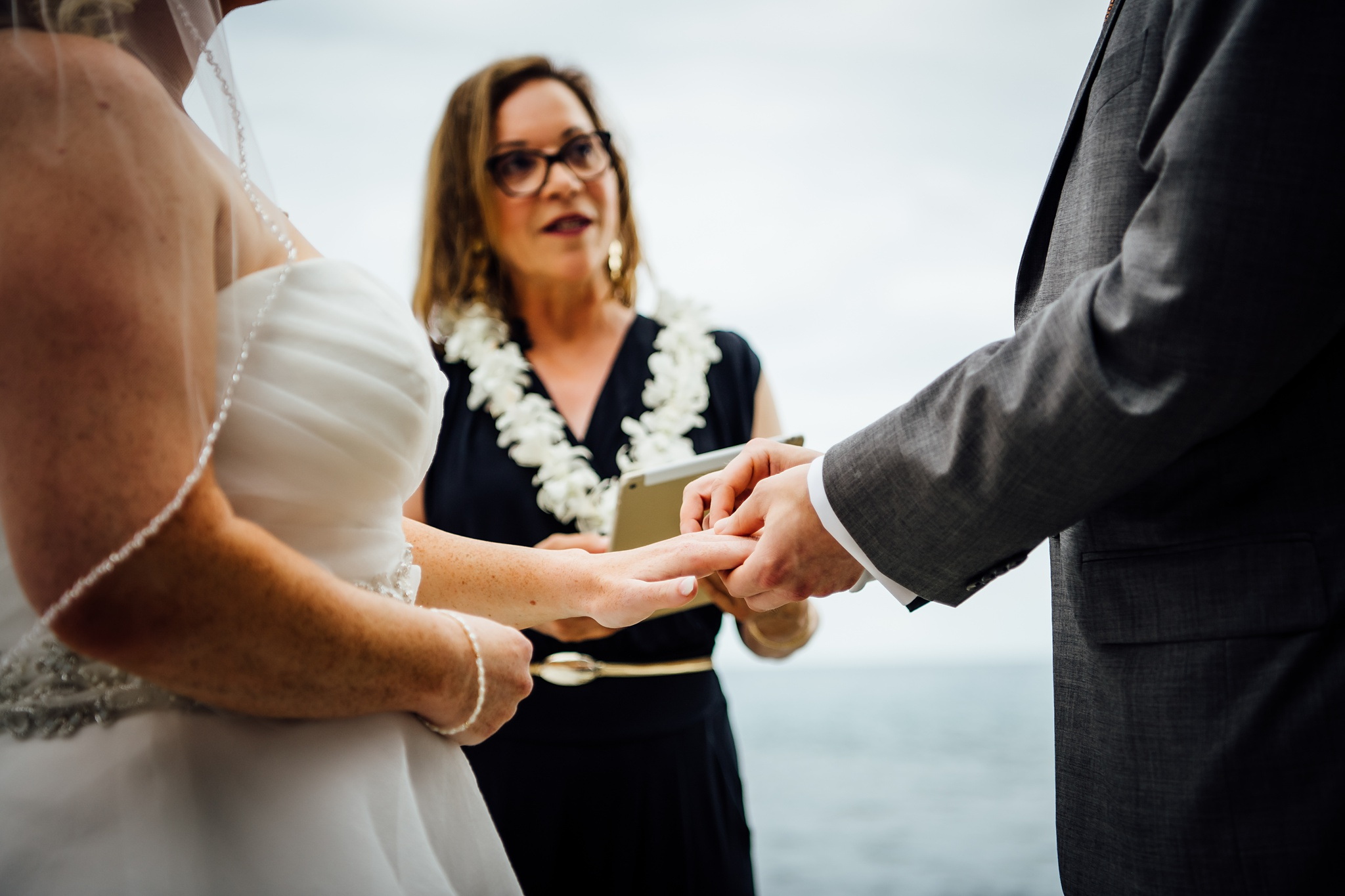 Wedding ring exchange during kona wedding