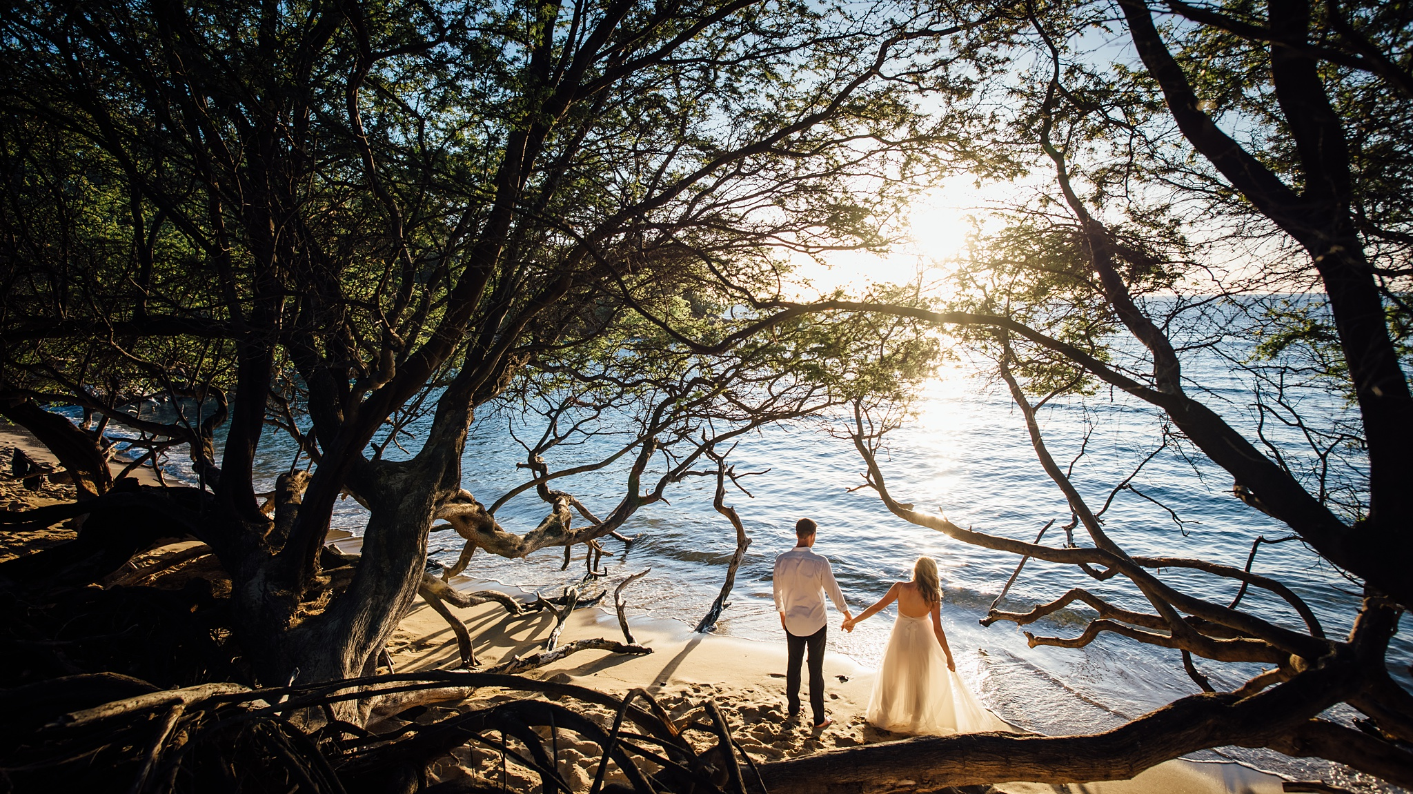 couple on their wedding day at waialea bay