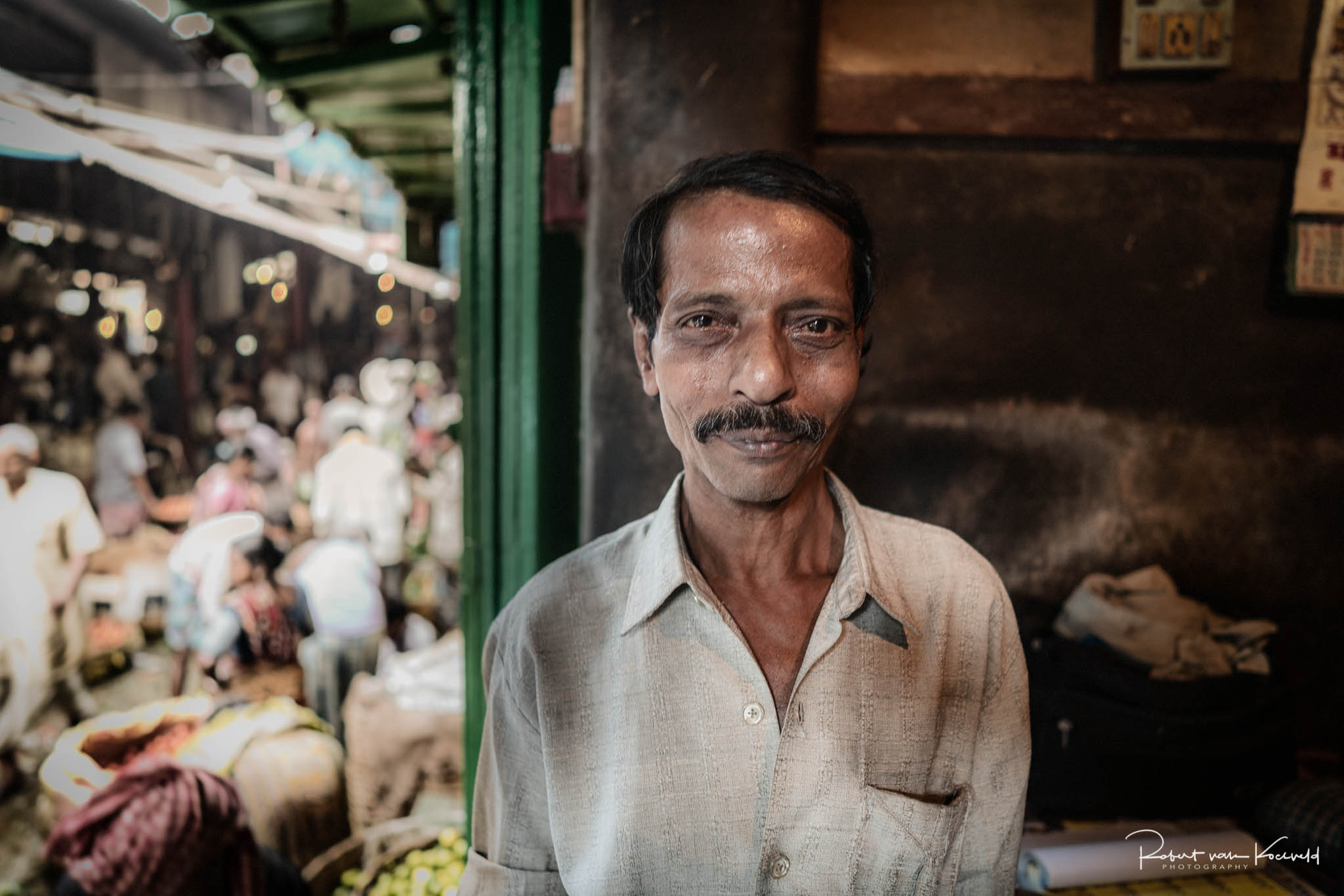 Talik Rai has been working at the markets for more than 15 years. He operates one of the scales used to weigh produce as it is bought and sold.