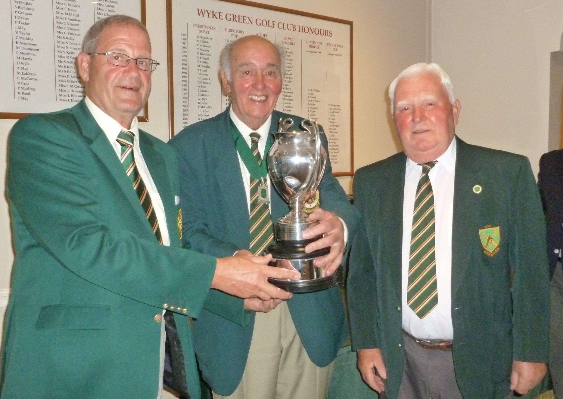 President Harry Judd presenting Peter Lowe, Datchet Golf Club and Jim Smith, Hillingdon Golf Club. winners of the Henderson Trophy for the best back nine holes.