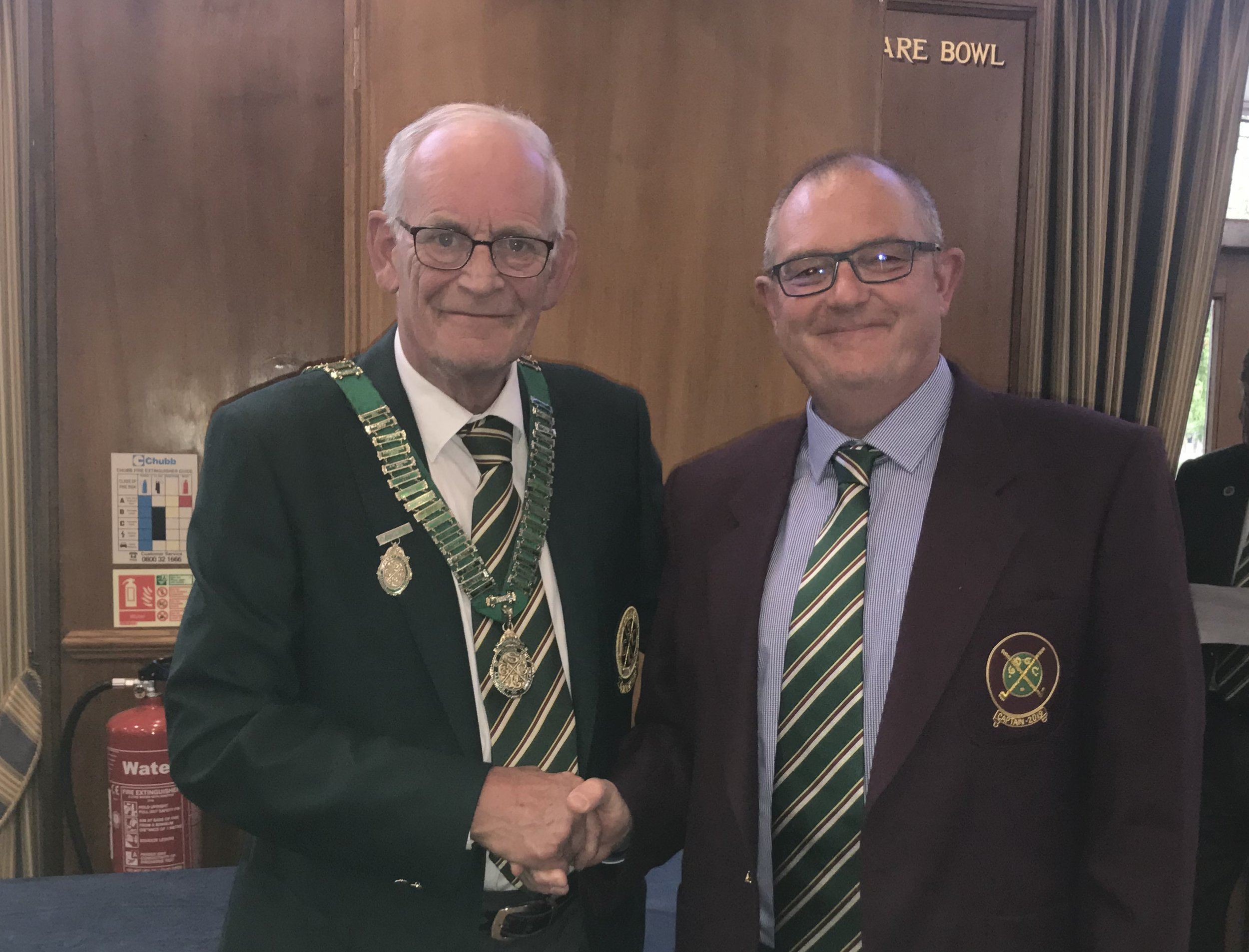 Steve McSweeney from Grim's Dyke Golf Club receiving the Reigning Captains prize from Society Captain Peter Cansick