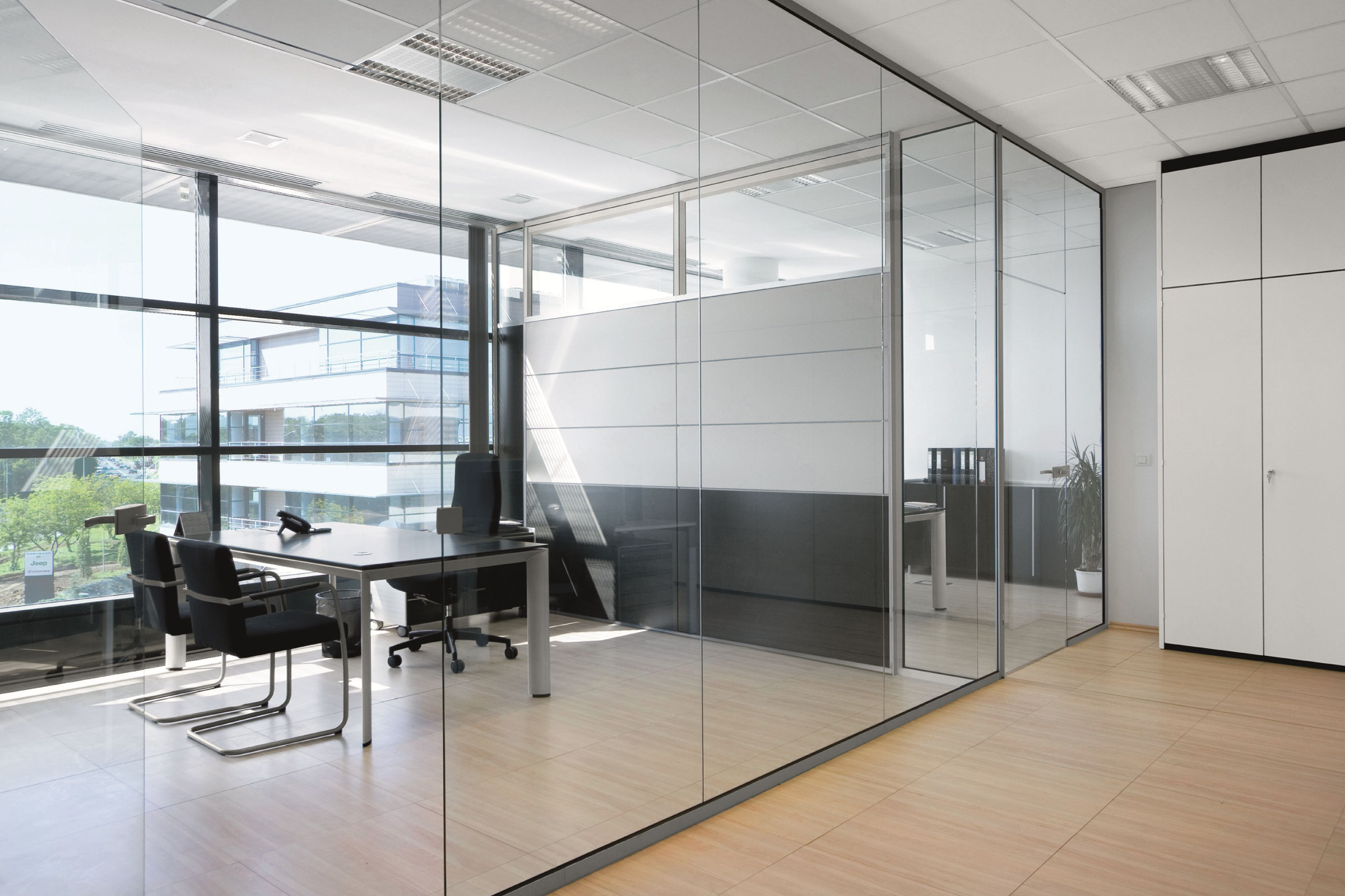 COMMERCIAL GLAZING   The supply and installation of glass office partitions, frameless doors, Aluminium doors and channels.