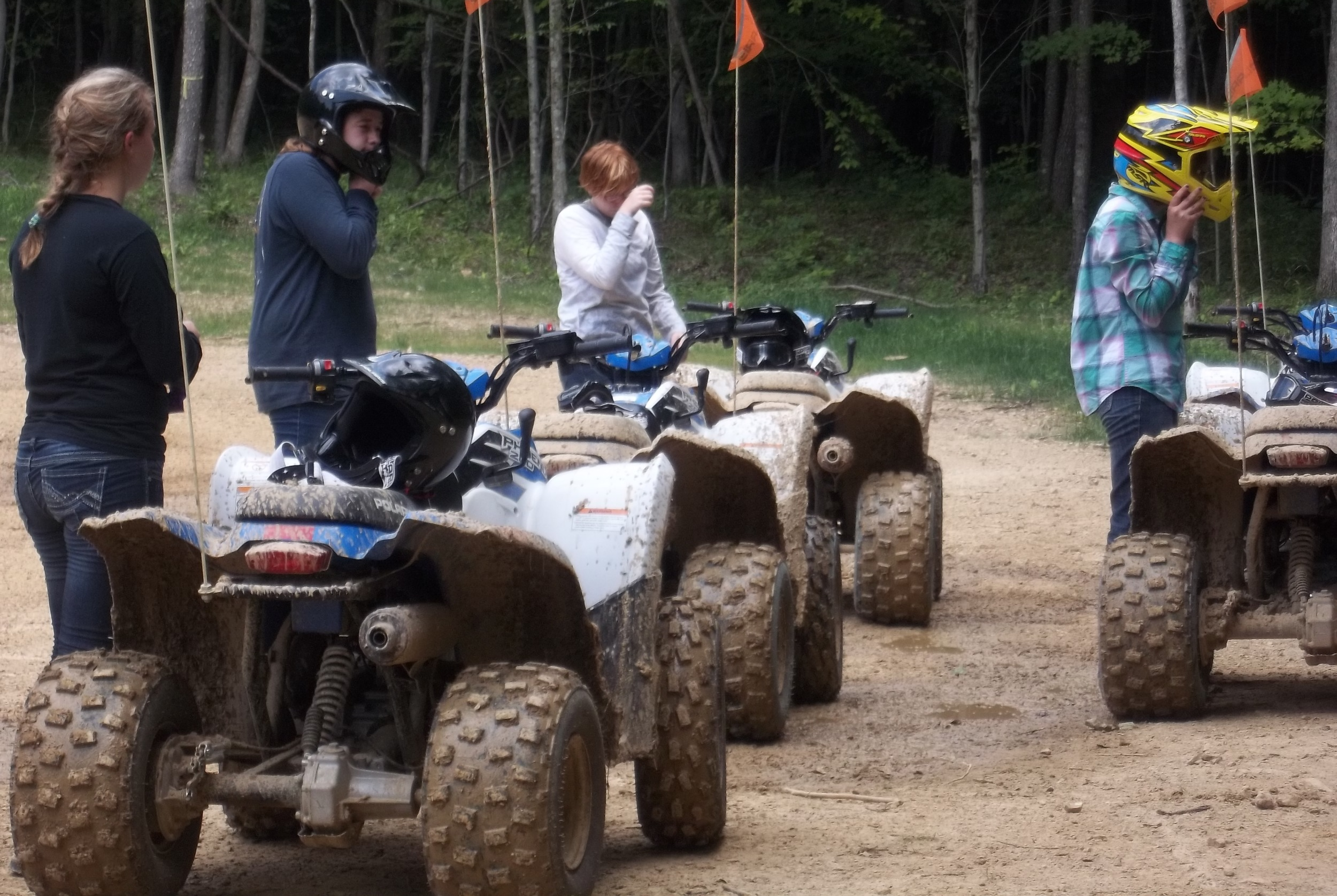 Scouts prepare to mount their ATV's and do a circuit ride around camp.