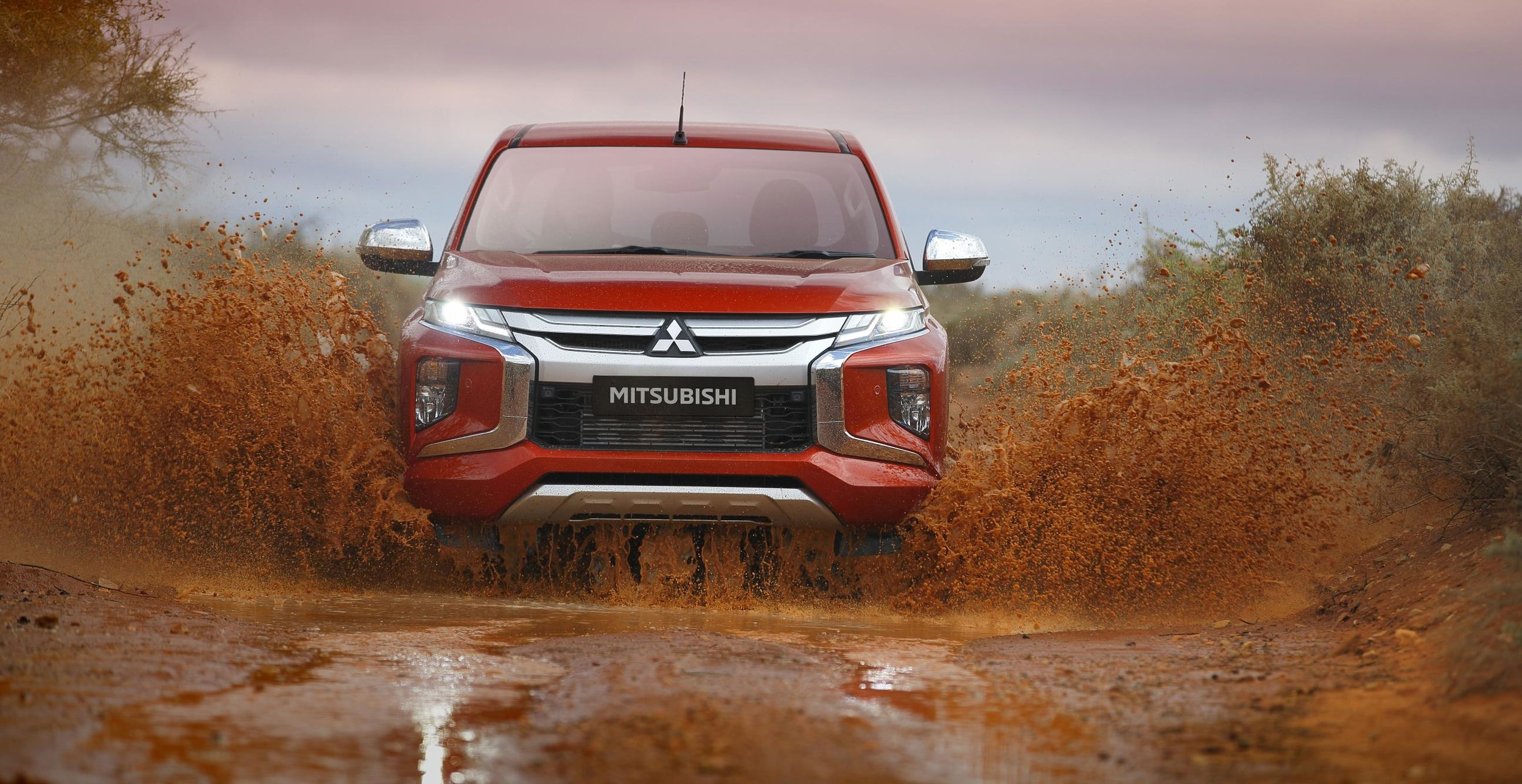 L200 front-driving-through-mud.jpg