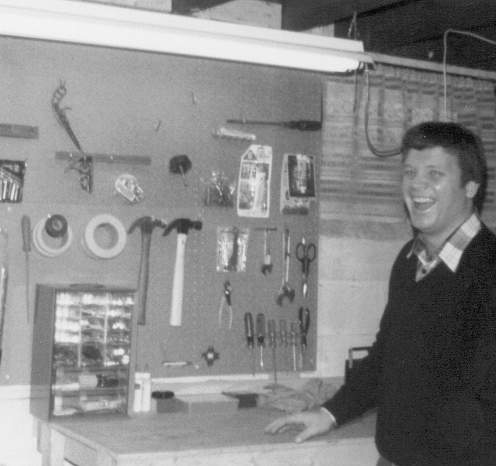 My father, standing proud in front of his first workbench.