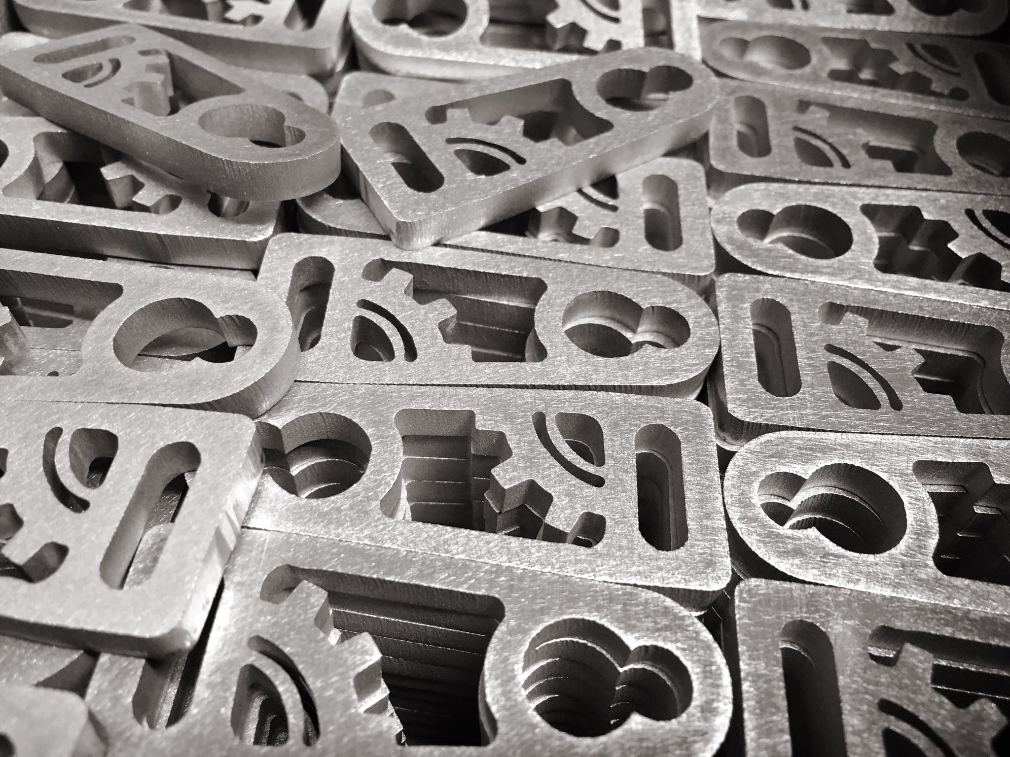 Abrasive CNC Waterjet cut latch pulls in raw form. Headed to tumbling and anodizing!