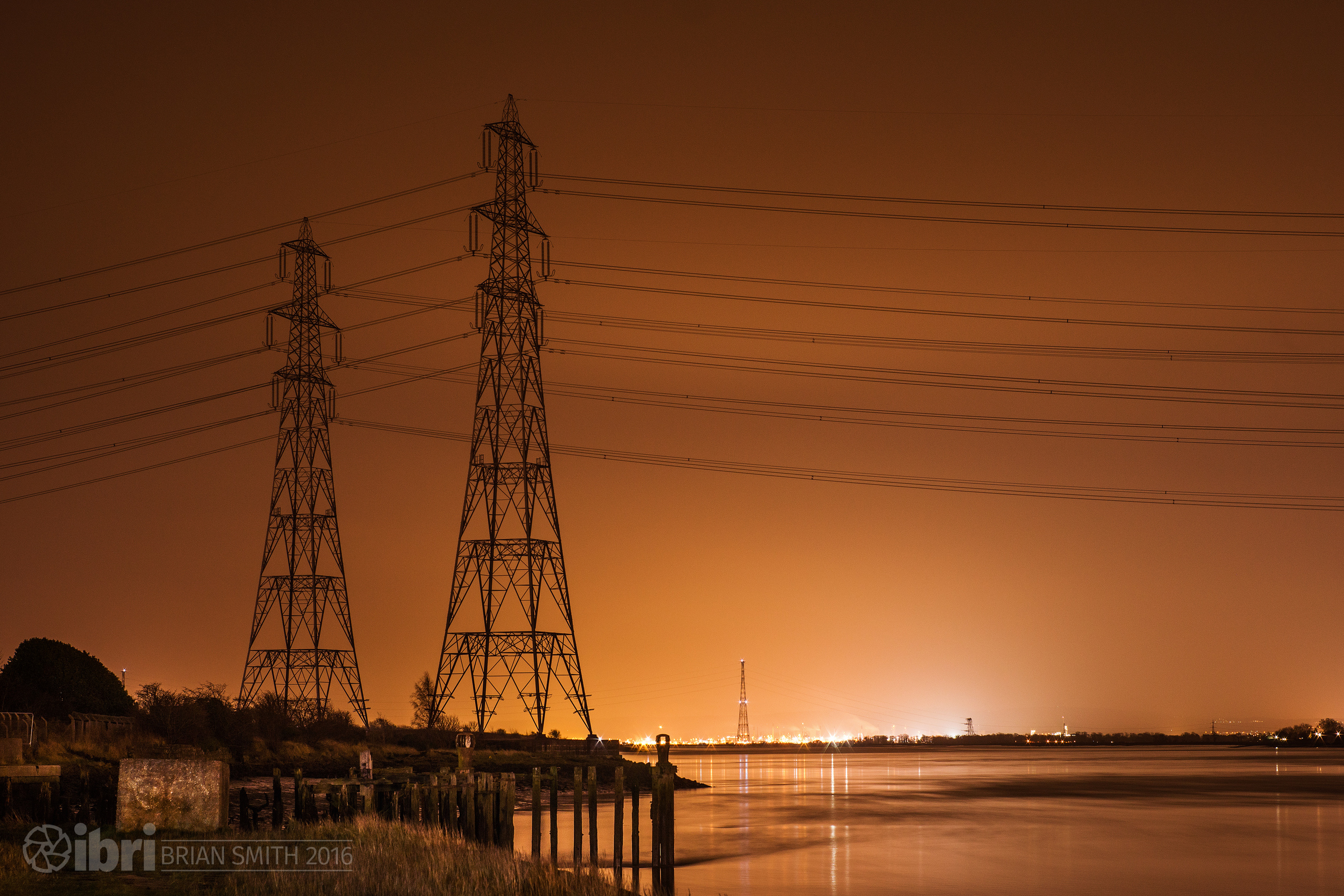 Power in the cables that carry electricity over the Forth here, power on the horizon under the glow from Grangemouth.