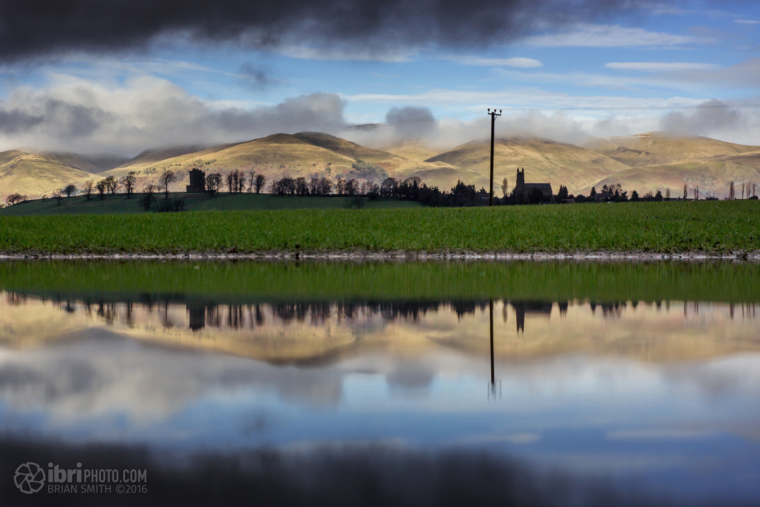 The silhouette of Clackmannan Tower and church reflected in a flooded field. Was nice to see the Ochils catching some rays though.