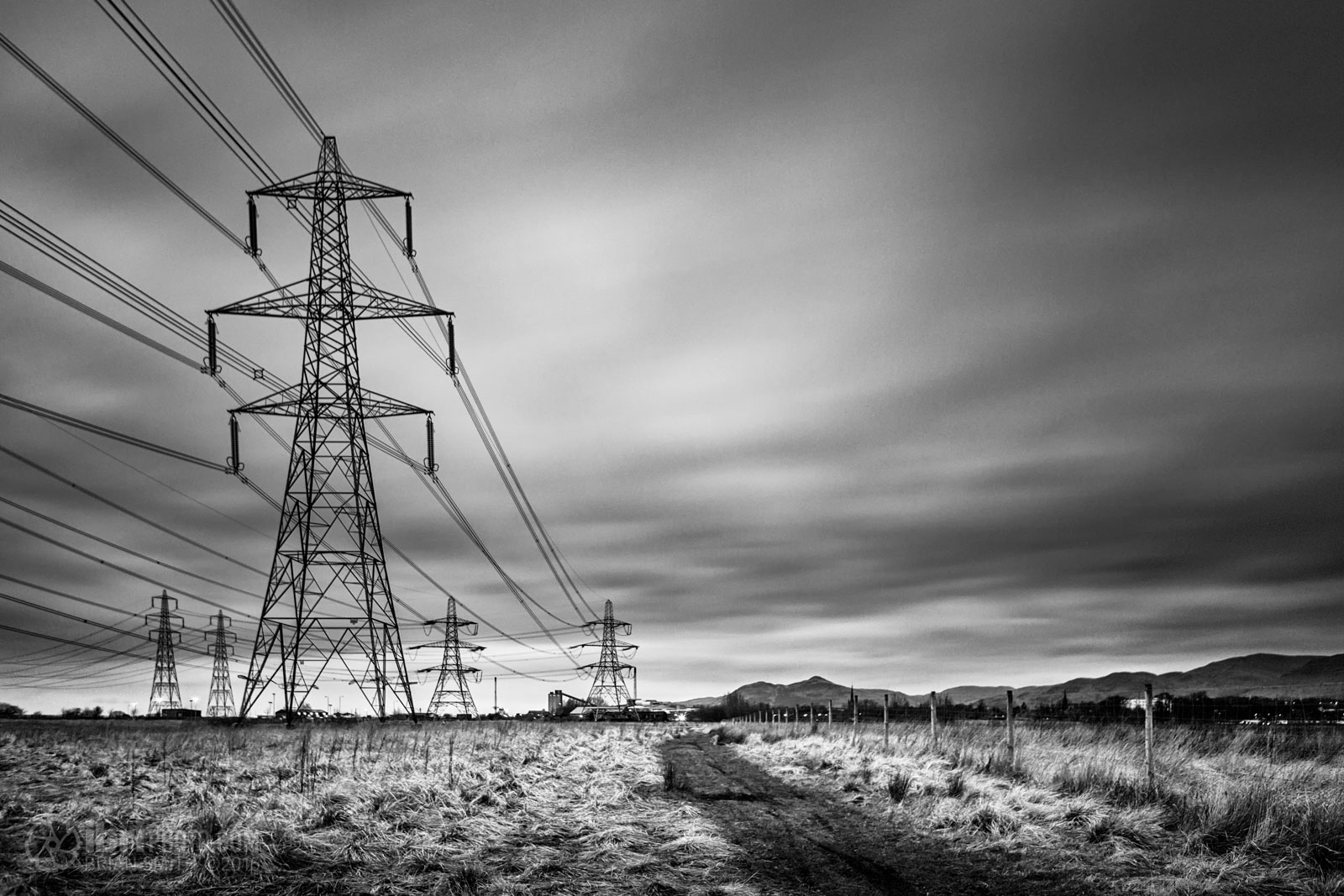 After applying the Lens Correction Filter the pylons are back to vertical.