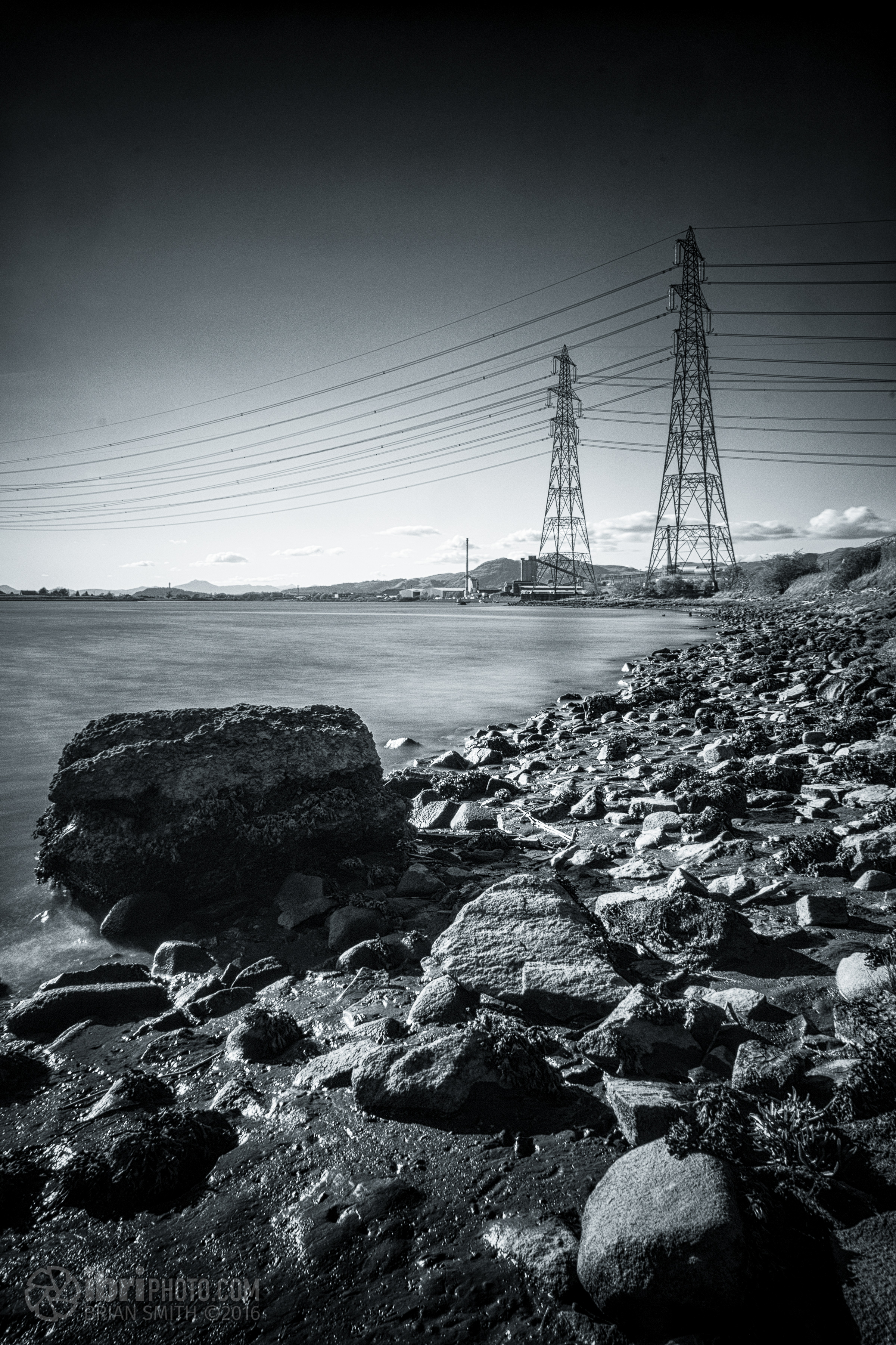 The usual pylons, this time shot from a bit further down the River Forth, with the glass factory beyond.