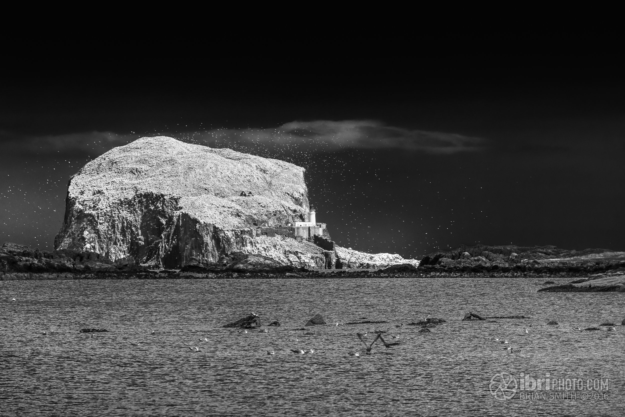 The rock looks like it's being pelted with giant snowflakes here. Used a polariser to enhance the effect and to turn the blue sky dark during conversion to black and white.