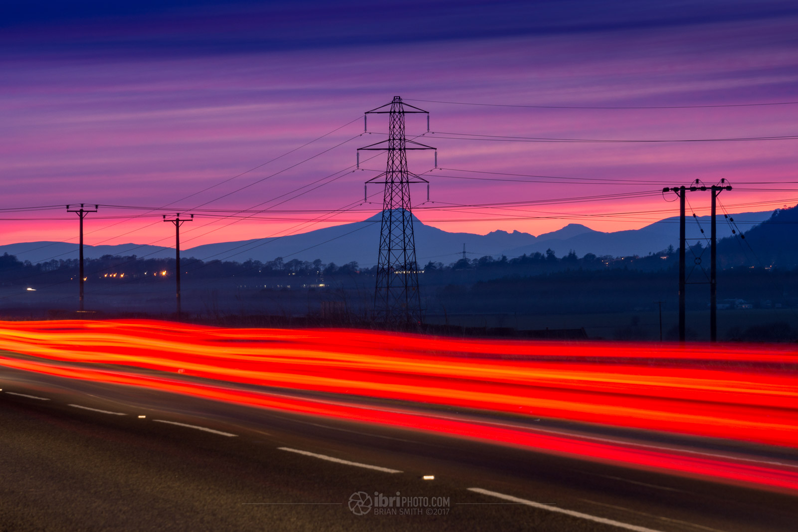 Light Trails and a pink sky, about 35 minutes after sunset, from near Tullibody, Clackmannanshire. Sony Nex 7 - Sony E 55-210mm f4.5-6.3 OSS - 110mm - 10sec - f4.5 - ISO100