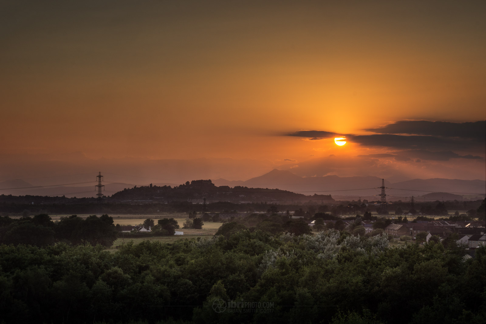 This image of the sun setting over Stirling is a composite of 3 differently exposed photographs.