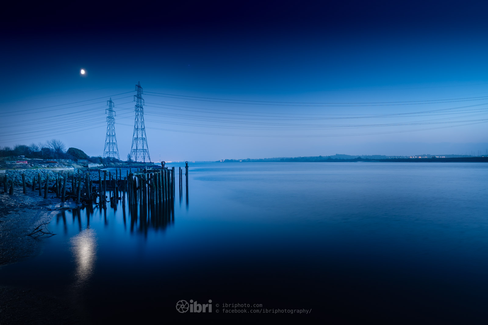 The moody old stumps of the abandoned piers, with the moon and mars sailing over the pylons that hoist electricity over the Forth (Mars is the tiny spec to the right of the moon at the end of the pier).