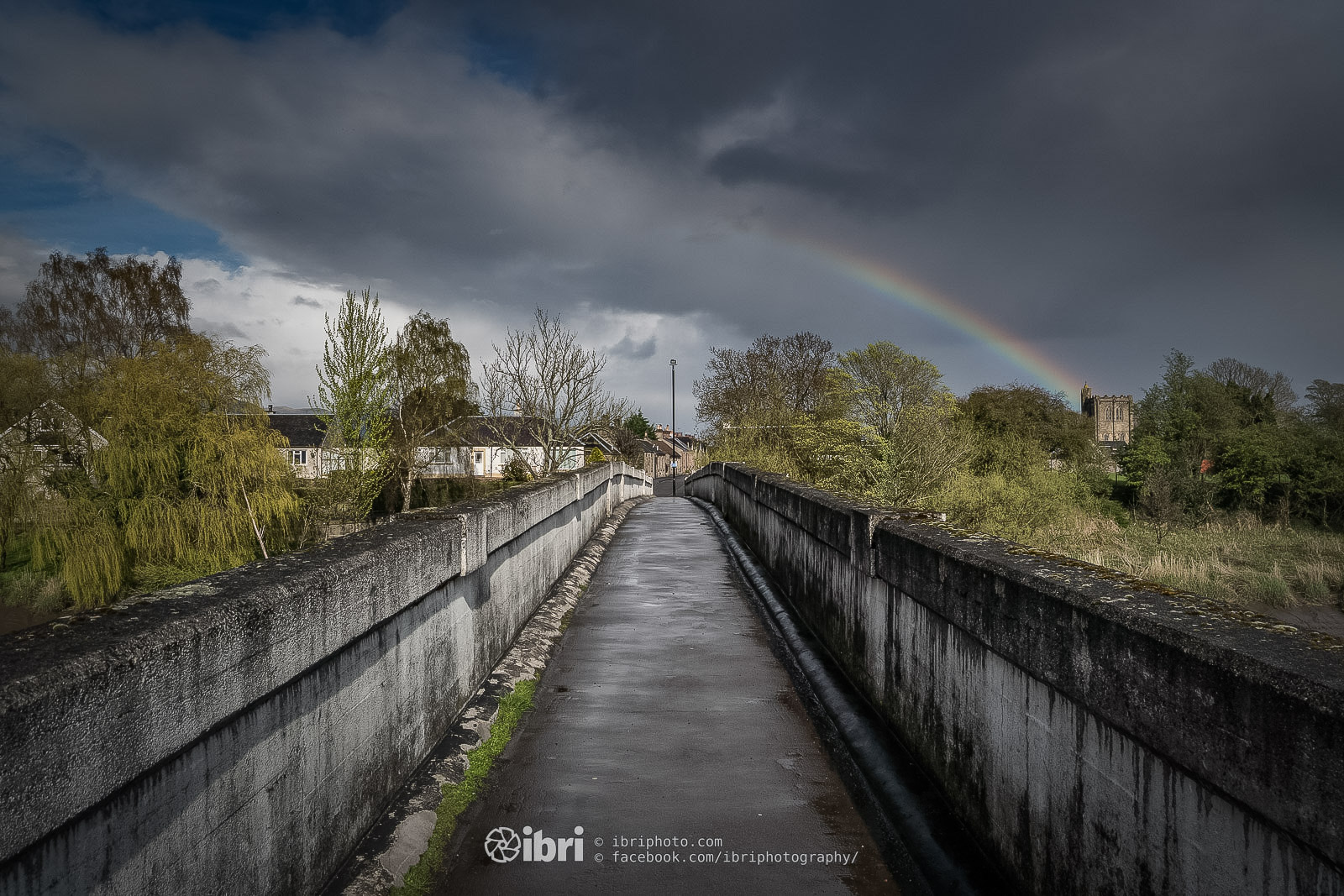More April showers. Crossing the River Forth at Cambuskenneth as a rainbow arches to the Abbey.