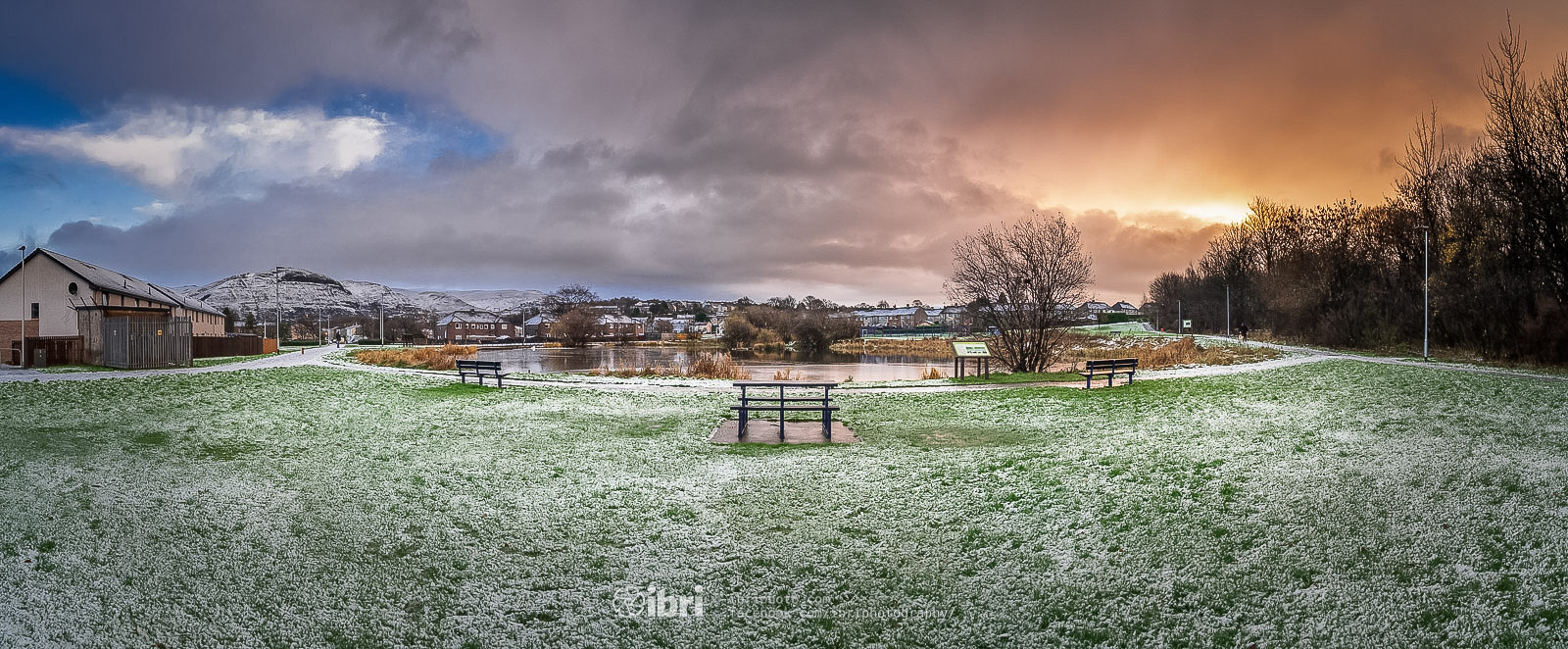 The morning after the first winter storm. Panoramic stitch of the local village pond just after sunrise on a quiet and chilly Sunday morning.