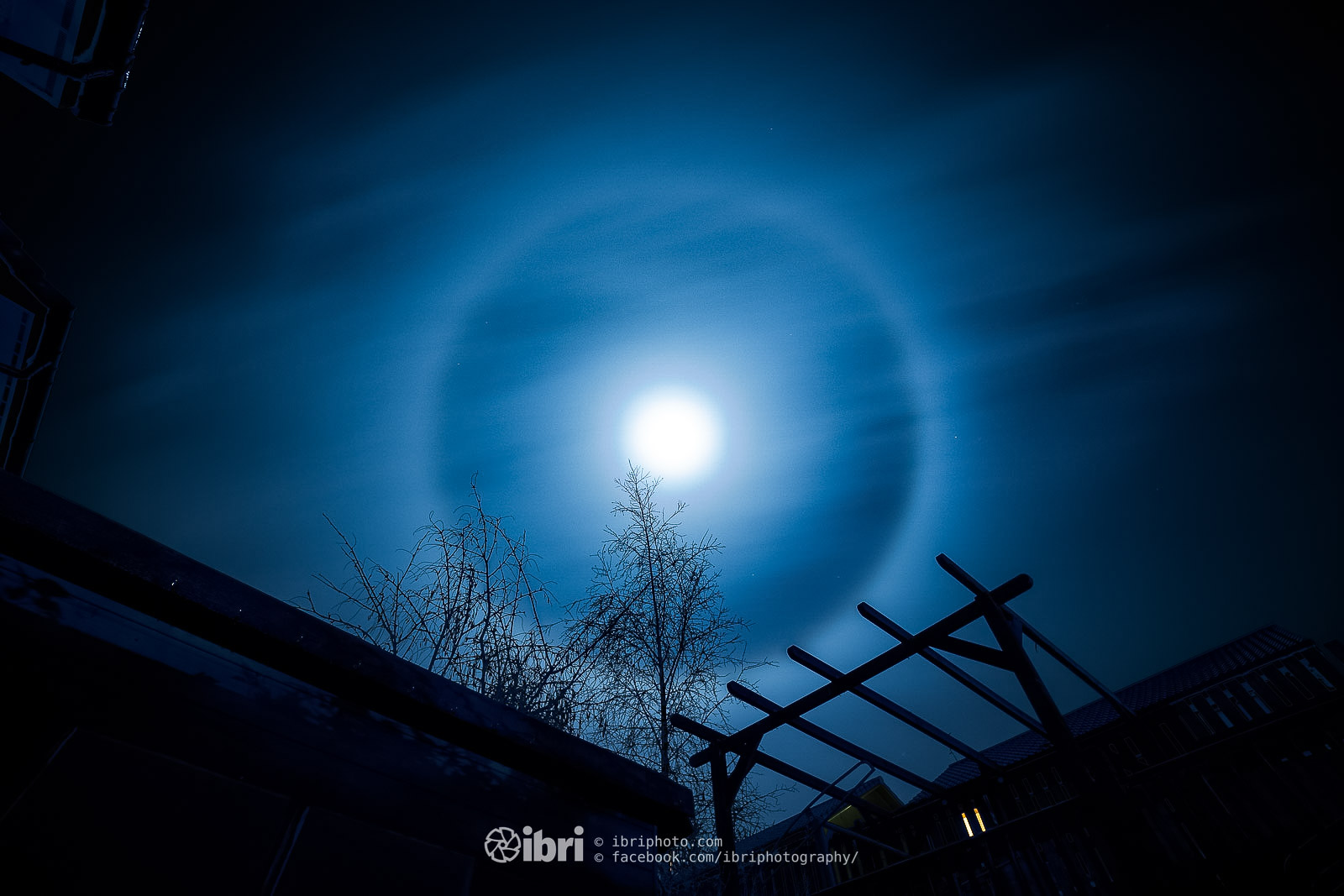 22˚ ice halo shining bright and beautiful around a December morning's  full moon in Scotland.