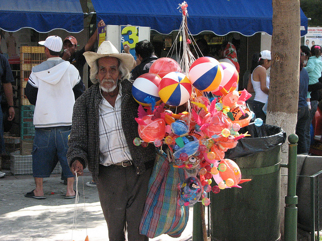 Poor Mexican street vendor (disguised unemployment)
