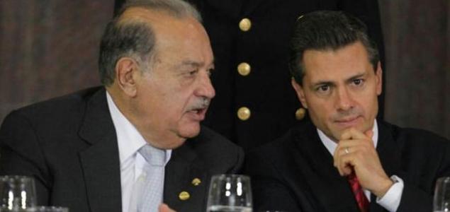 Businessman Carlos Slim and President Enrique Peña Nieto