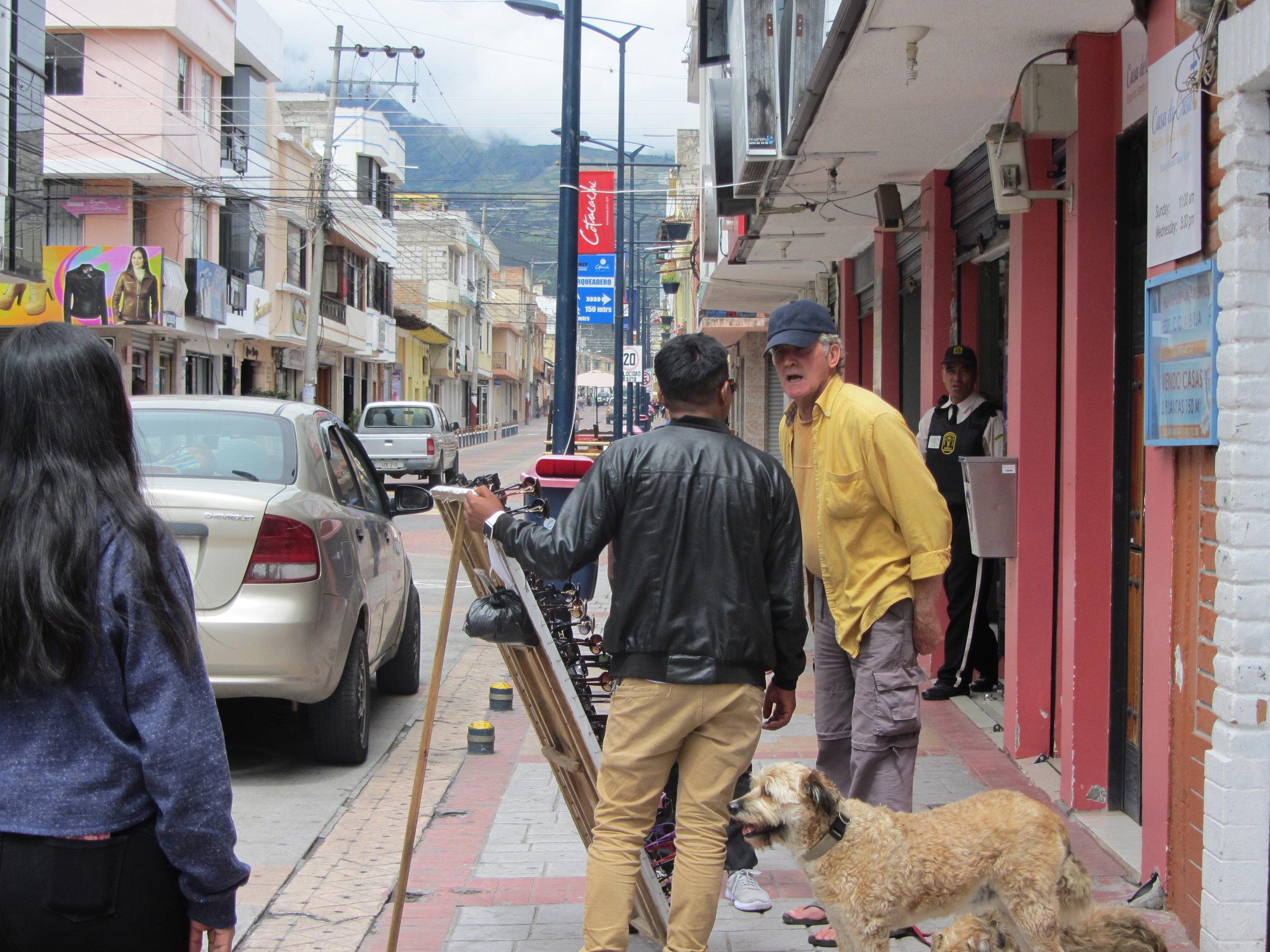 Expat negotiating the price of sun glasses in Cotacachi