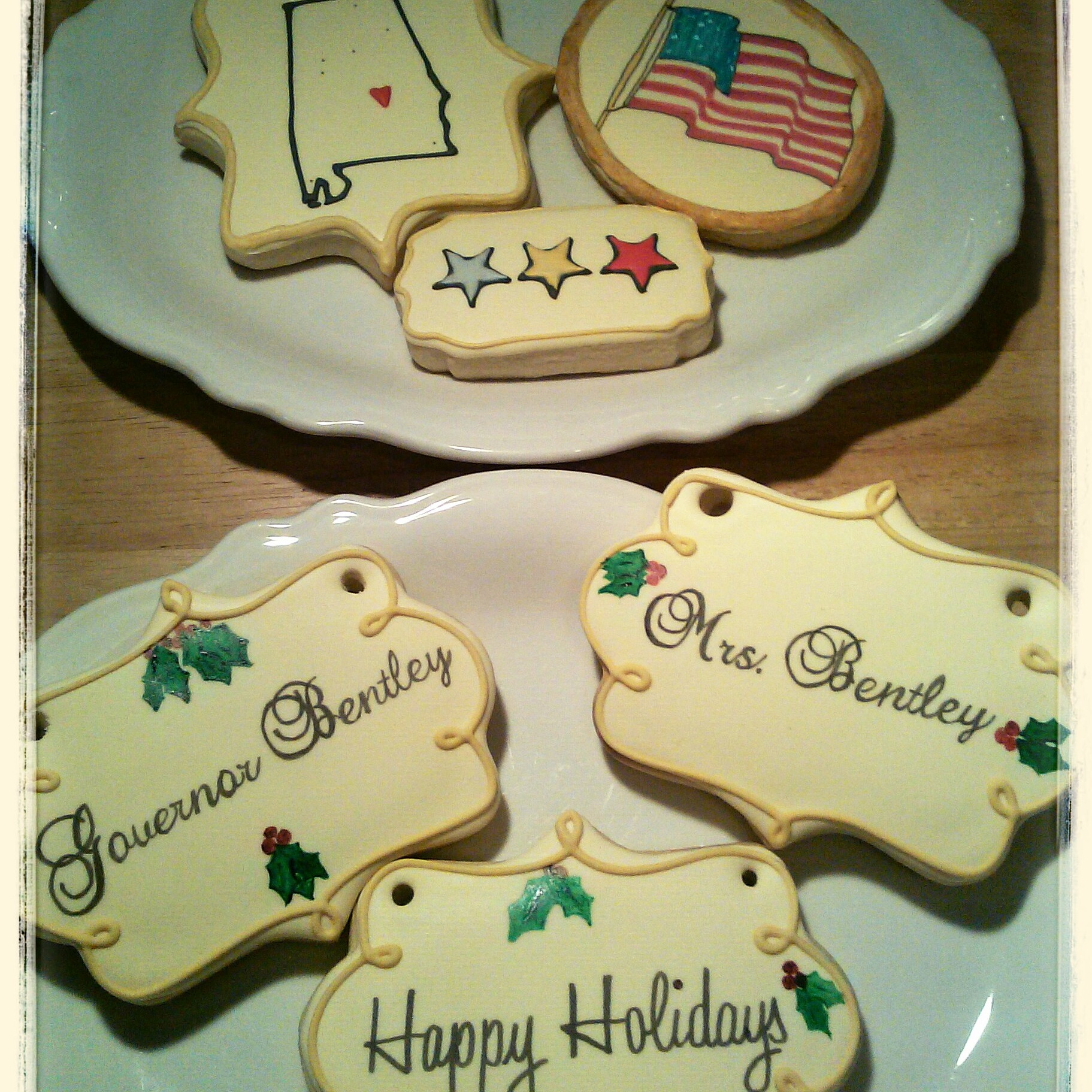 I added the holes on each side of the cookie so that they could be strung with ribbon and kept as keepsakes to hang on their tree. There was a cookie with each of the Governor's children and grandchildren's names as well as the Governor and his wife.
