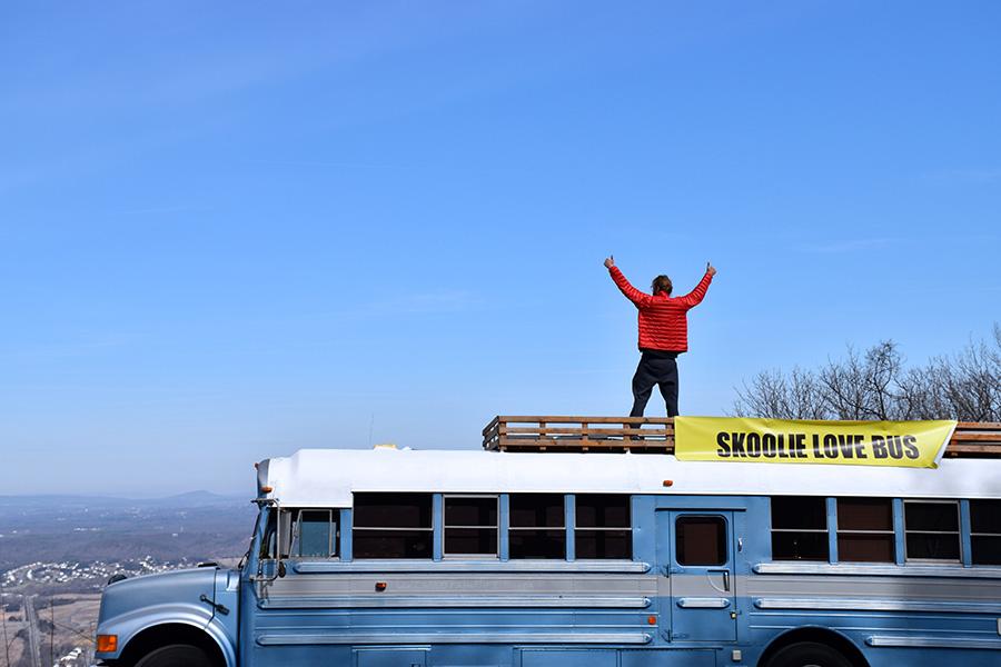thumbs-up-standing-skoolie-bus.jpg