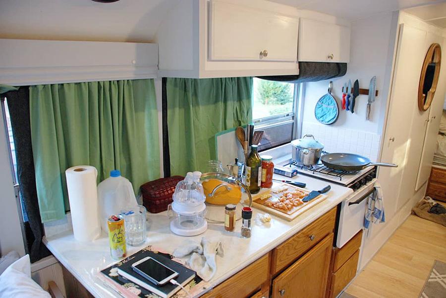 beautiful-renovated-kitchen-skoolie-love-propane-oven.jpg