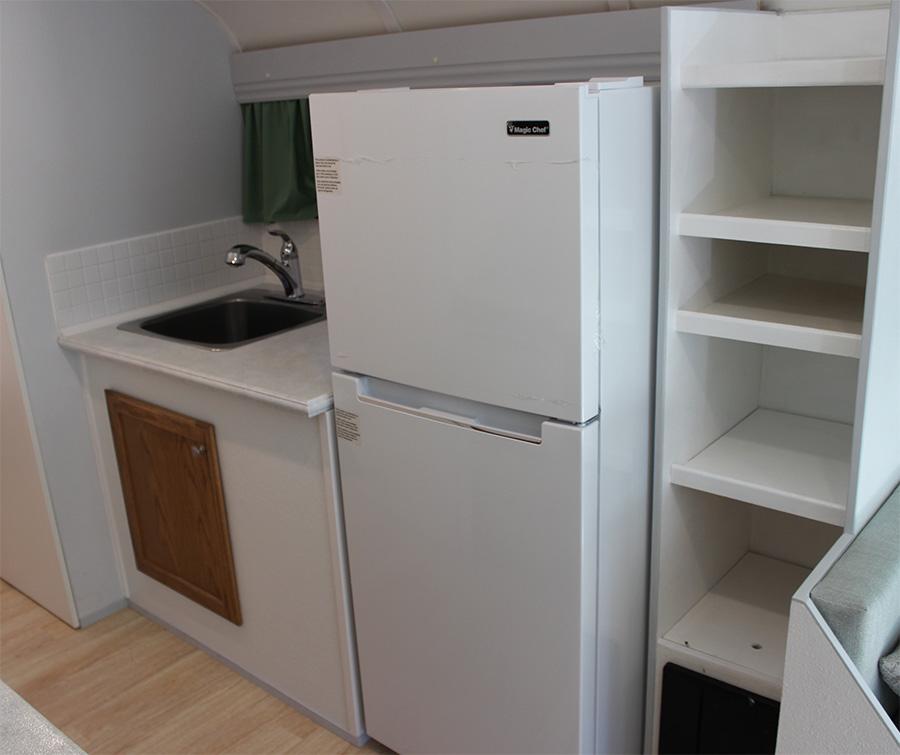 larger-fridge-skoolie-interior.jpg
