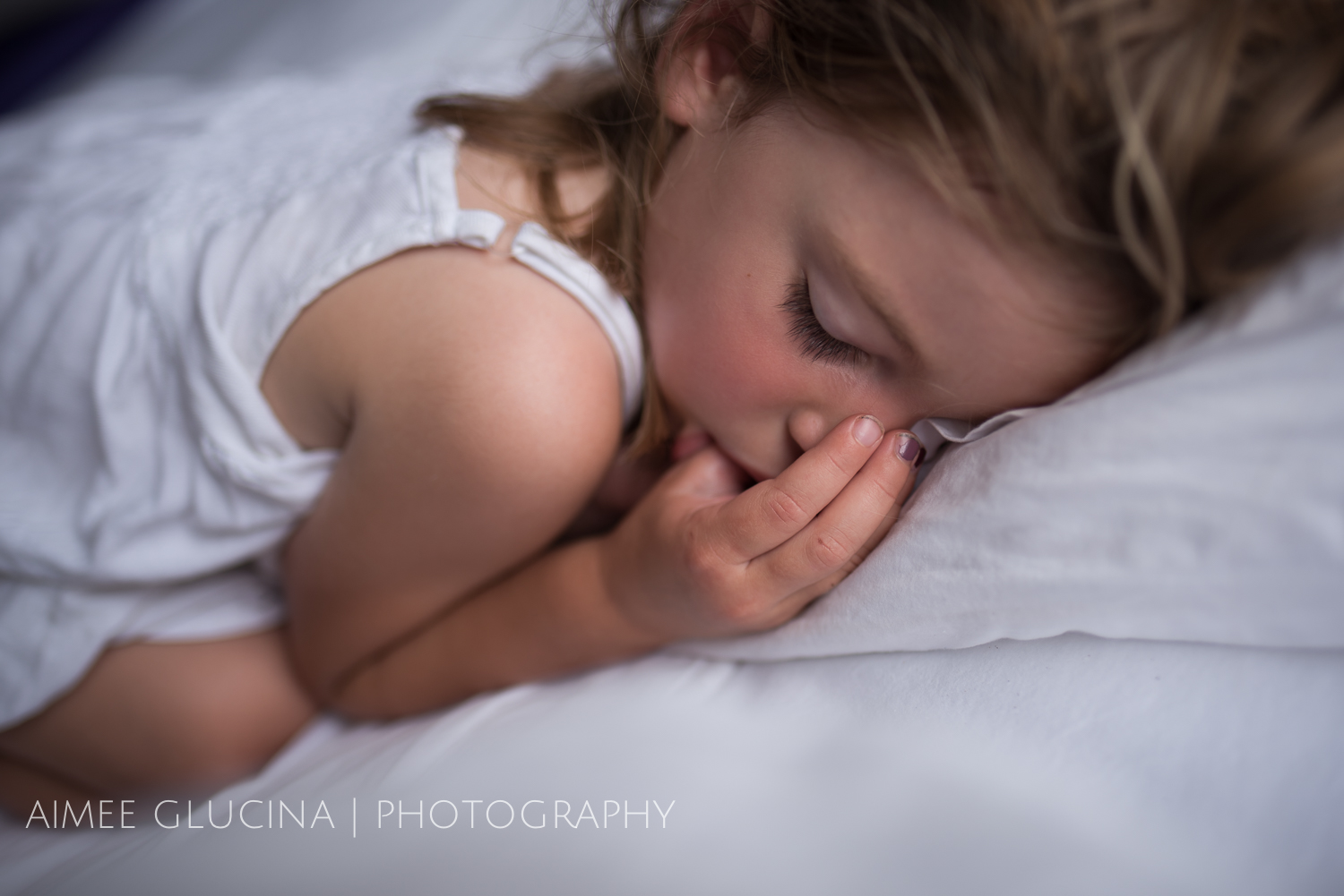 It's easier to get a good result if they're sleeping near natural light (here there was a big window above her head).