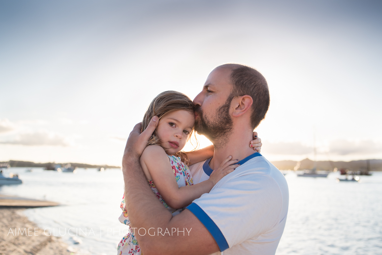 This is that warm golden light I'm talking about. Just be conscious that it's harder to get evenly lit faces if you're backlighting at sunset. Using a reflector will help, even if it's just that you're wearing a white shirt to bouncy some light back on your child's face.