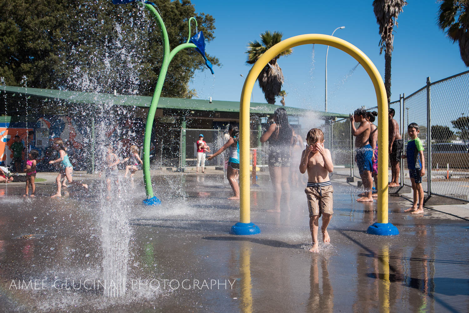 The splash pad was chaotic and full of colour and movement.