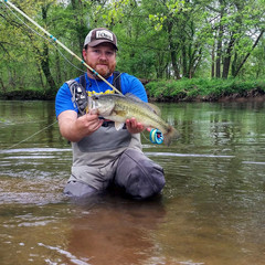 """Brandon is an engineer tech contractor for NASA by day and at night (after the wife and kids are sound asleep) you can find him at the vise pumping out orders for his """"lil""""shop  Panther Branch Bugs . He specializes in warmwater patterns, from deer hair bugs to streamers. He's a self-professed streamer junkie and loves that he learns something new each time he spends the day throwing meat."""