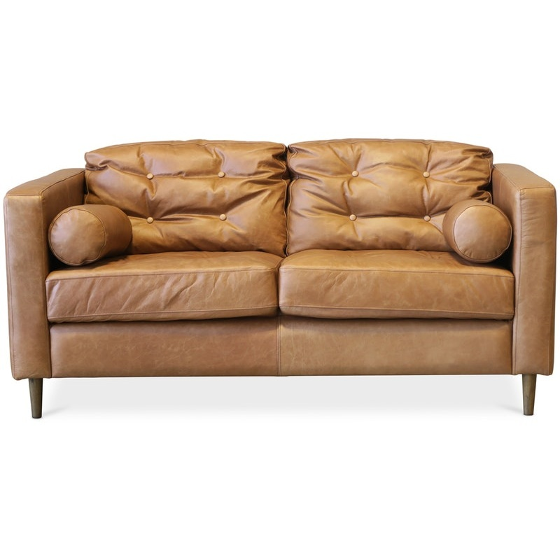 Cintesi Berkeley Tan two-seater sofa >>  Bold enough to hold its ground in this Turbo-charged room. The tan leather fits right in with the warm tones.