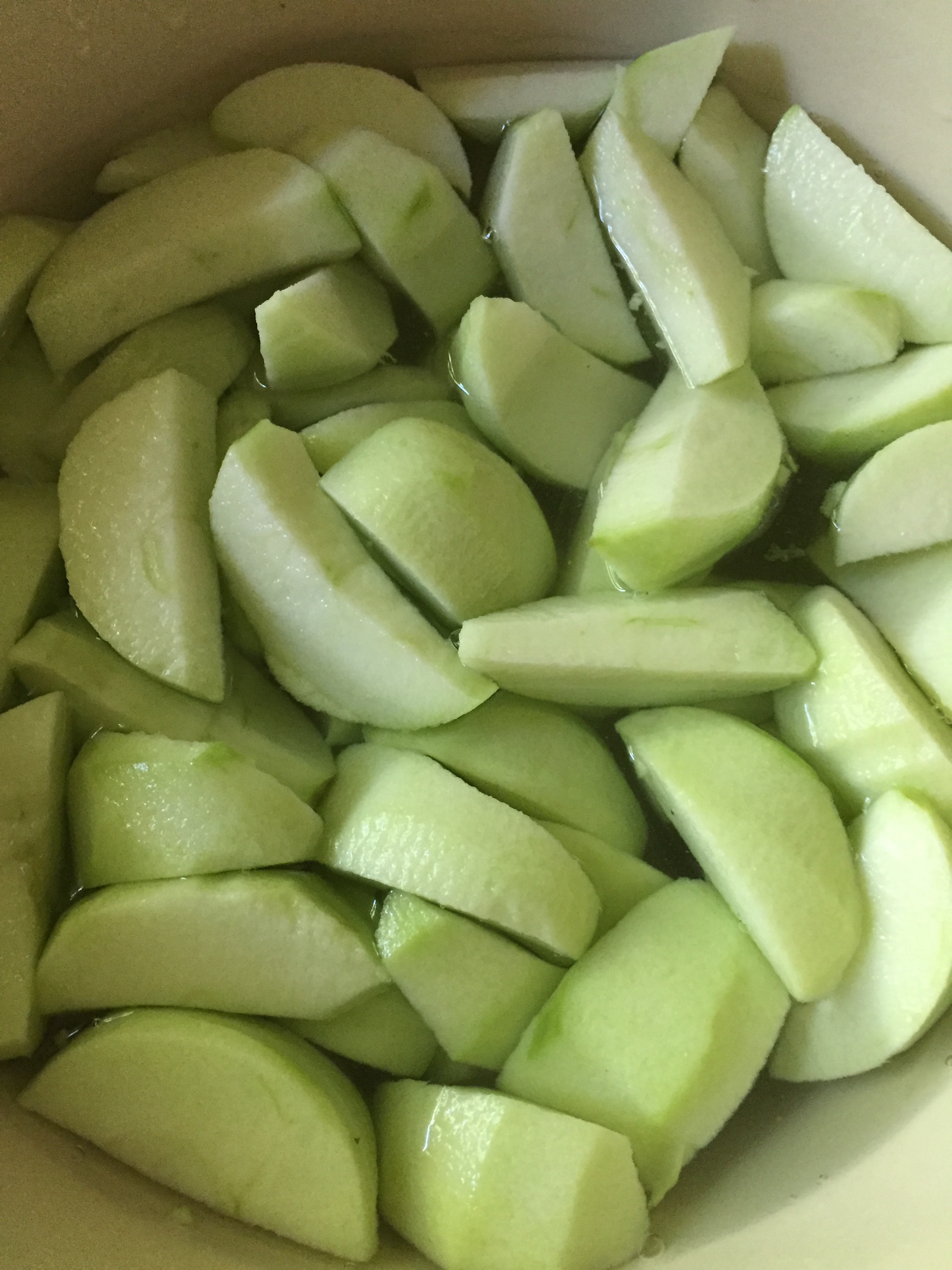 The apples soaking in a water bath with a little Ball 'fruit fresh' mixed in to keep them from browning