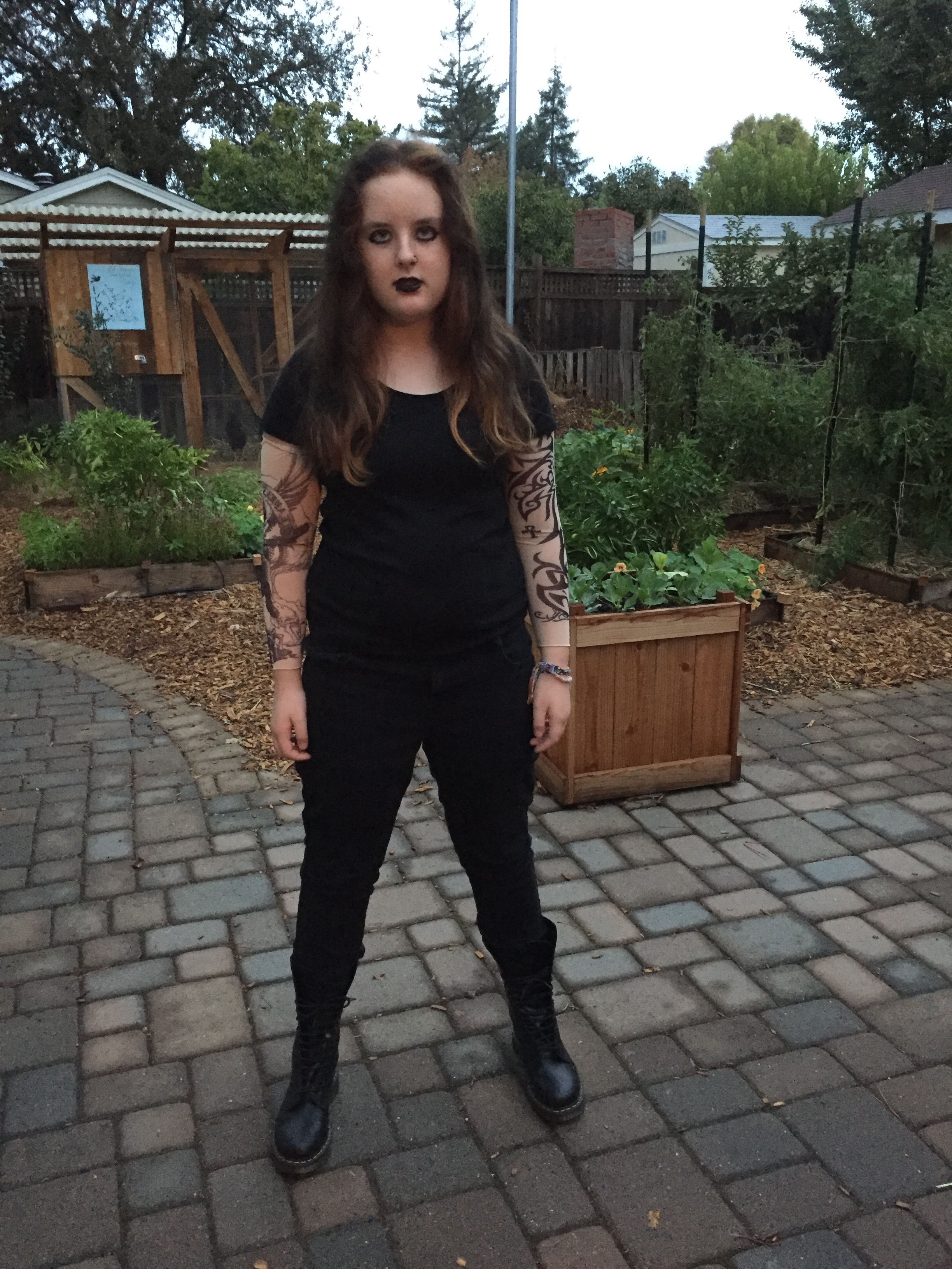 And this year, a pierced and tattooed Punk, wearing Doc Martens I would have killed for in the 90's. She looks a little too happy, even though I encouraged her to reflect on her angst and ennui.