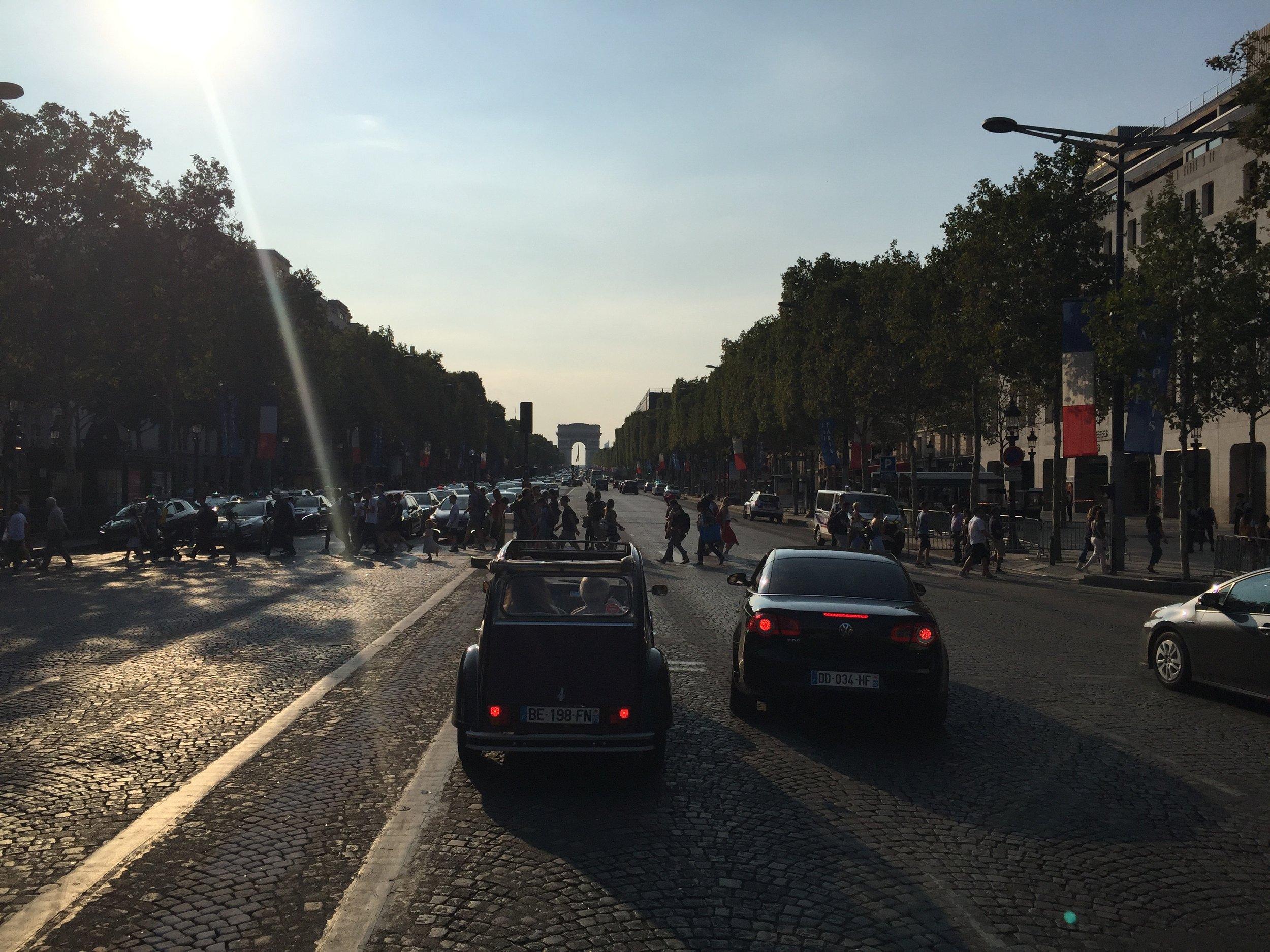 Driving down Champs-Elysees, towards L'Arc de Triomphe