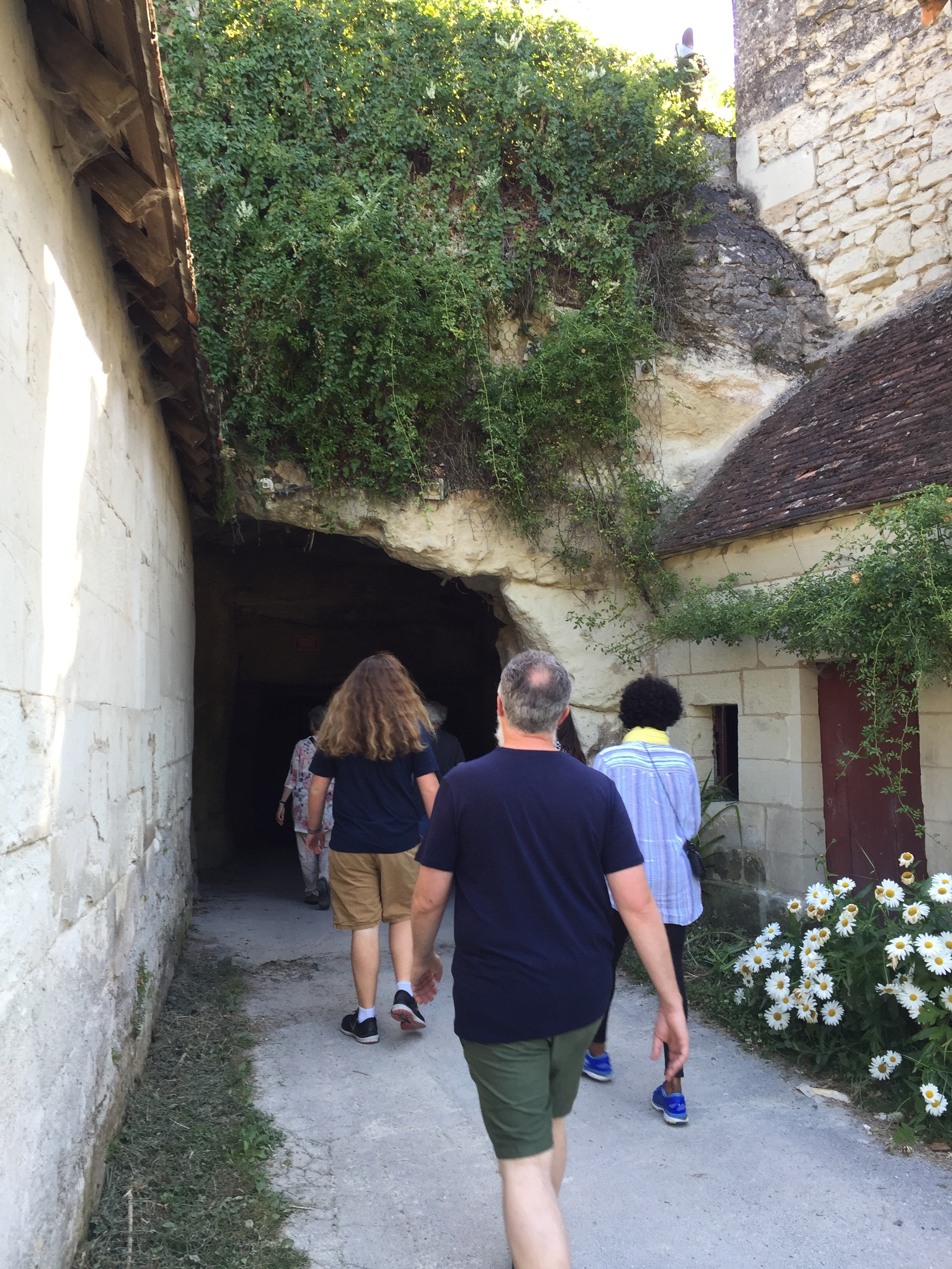 Entering Les Caves de Roche, the mushroom cave. No sign, no gate, no safety equipment required. We were told to keep up so we didn't get lost and duck under low ceilings.
