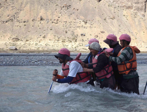 Outdoor skills training. NCF staff crossing the Spiti river, June 2015