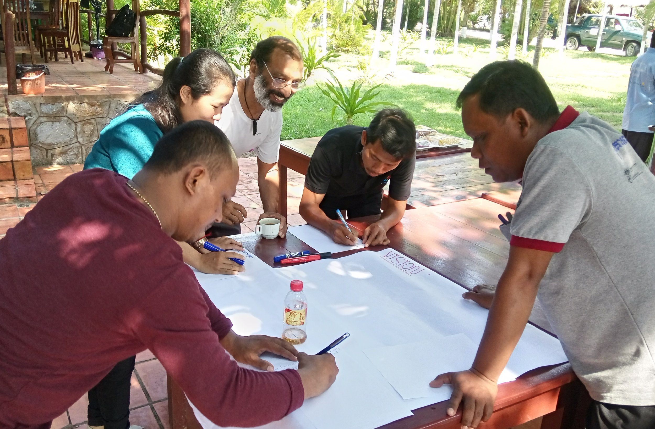 Its all about vision- what we see as real change.... and participation. I loved this workshop's setting-a whole team, working outside as waves lapped on a rocky shore behind us and breeze tousled scraggly coconut palms above..