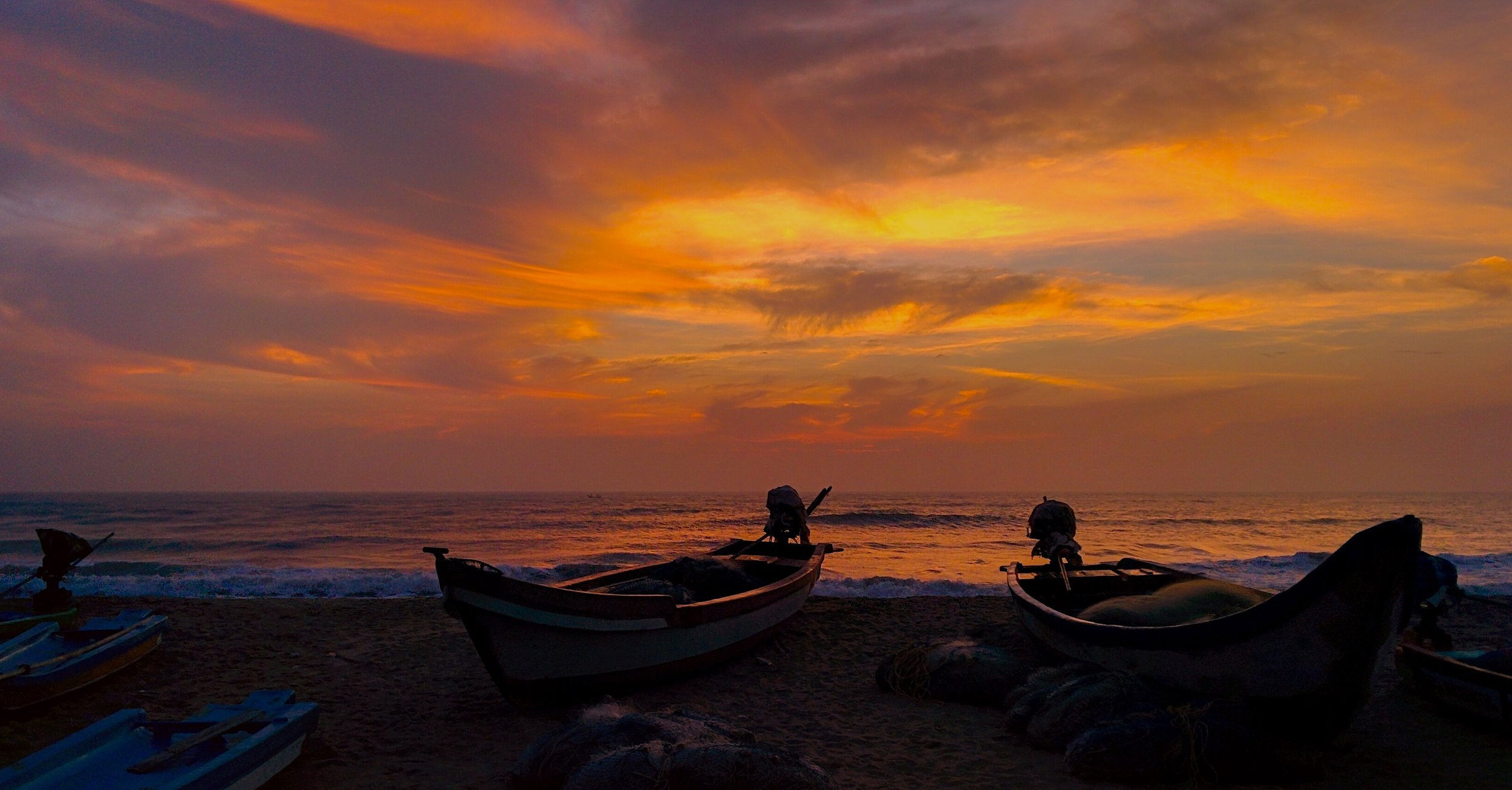 Silhouettes against a sultry sky. An idyllic Pondicherry dawn... but watch your feet!